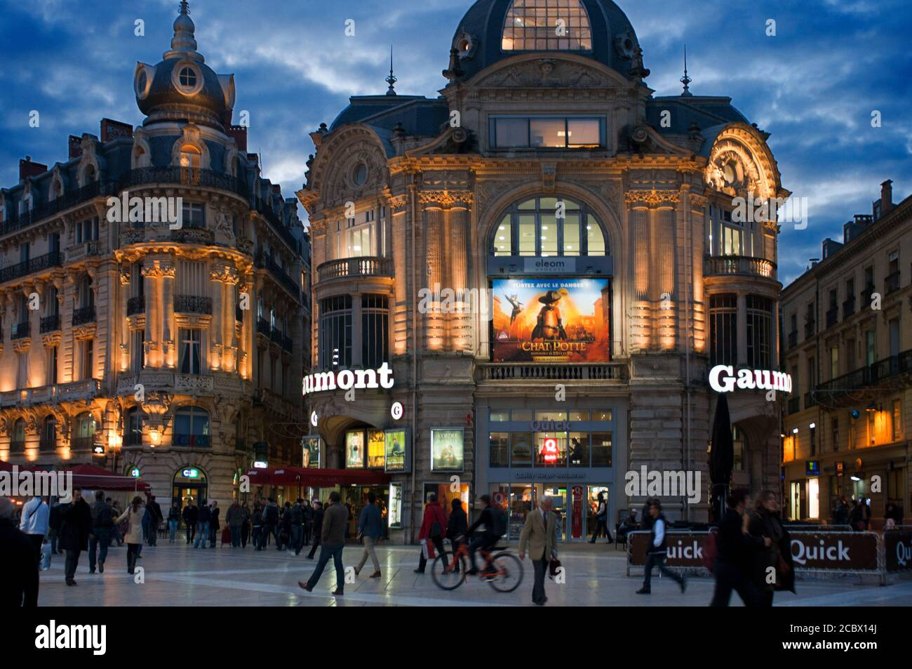 Gaumont Cinema Place de la Comedie Montpellier Languedoc Roussillon France.  Bars and restaurants in the Plaza de la Comedia. It constitutes the nerve Stock Photo
