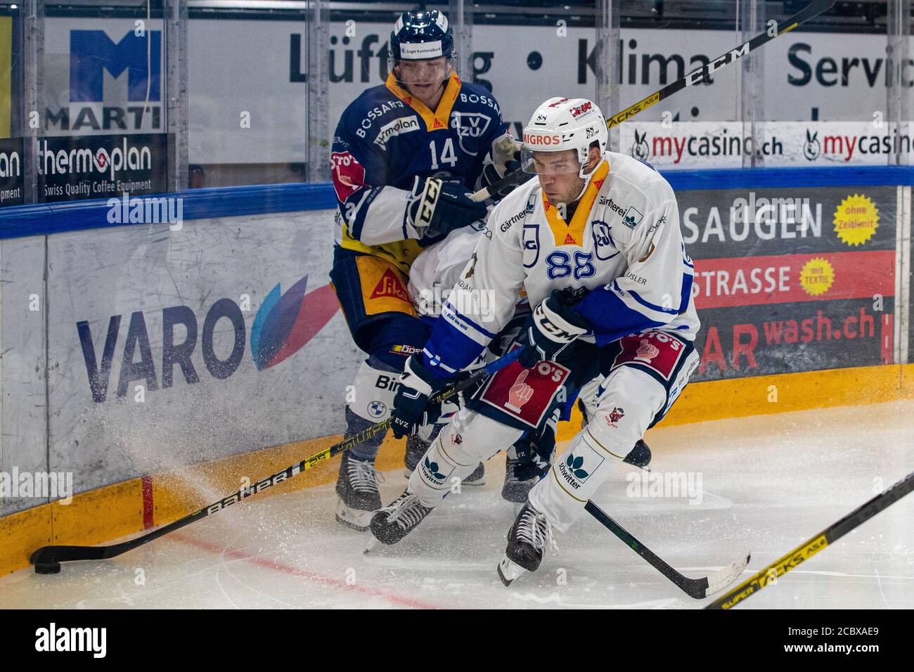 Anton Gradin # 88 (EVZ Academy) in front of Livio Stadler # 14 (EV Zug) on the puck during the National and Swiss League preparation ice hockey game between EV Zug and the EVZ Academy on August 16, 2020 in the Bossard Arena in Zug. Credit: SPP Sport Press Photo. /Alamy Live News Stock Photo