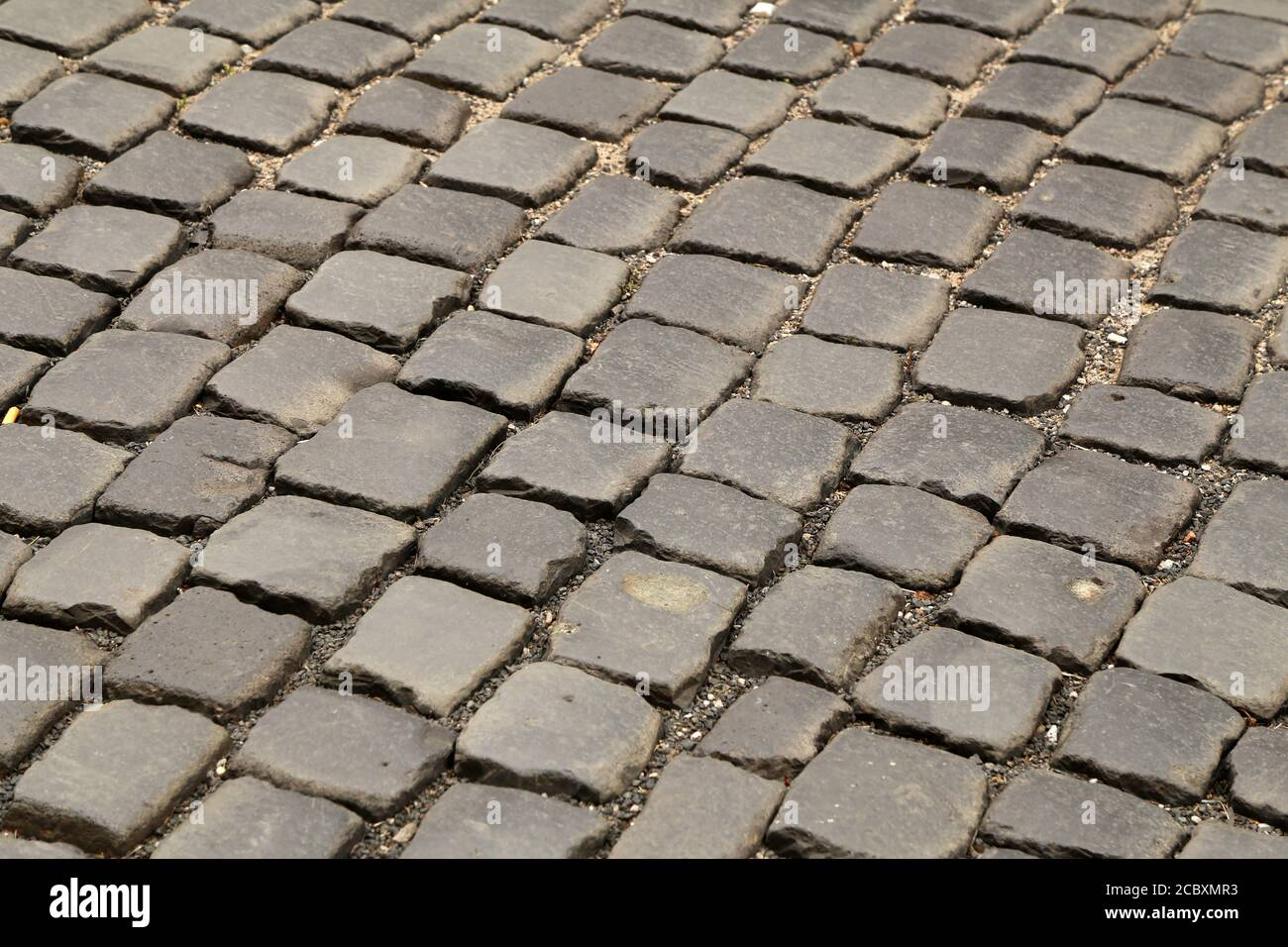Abstract background of old cobblestone pavement close-up Stock Photo