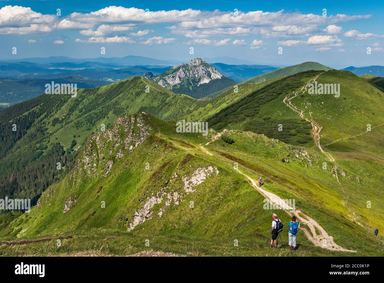 Velky Rozsutec mountain in far distance, Stoh massif on right, hikers, view NE from summit of Chleb, Mala Fatra National Park, Zilina Region, Slovakia Stock Photo