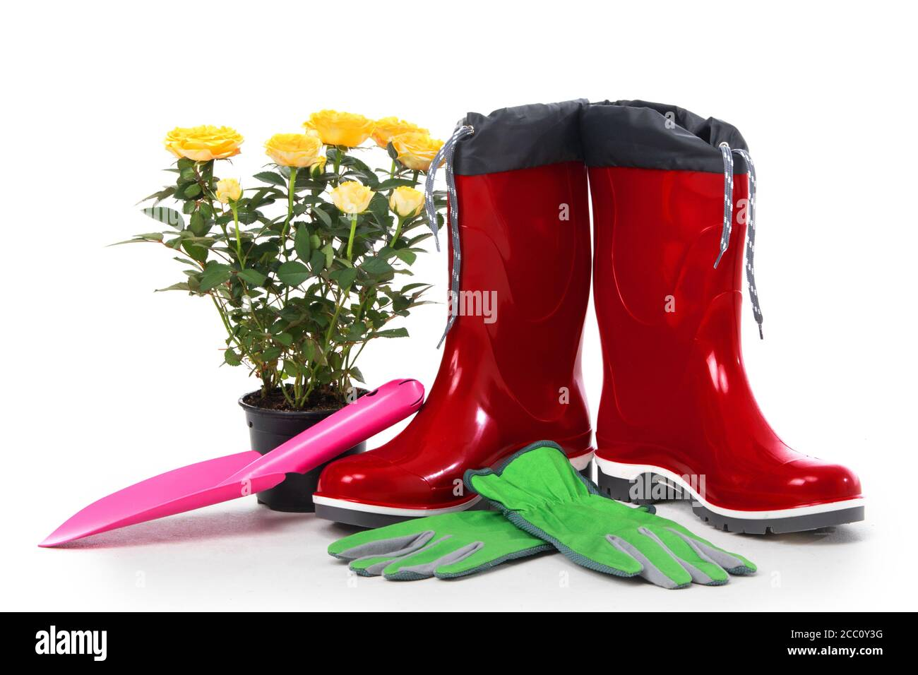 Garden tools with flower pot and boots isolated on white background Stock Photo