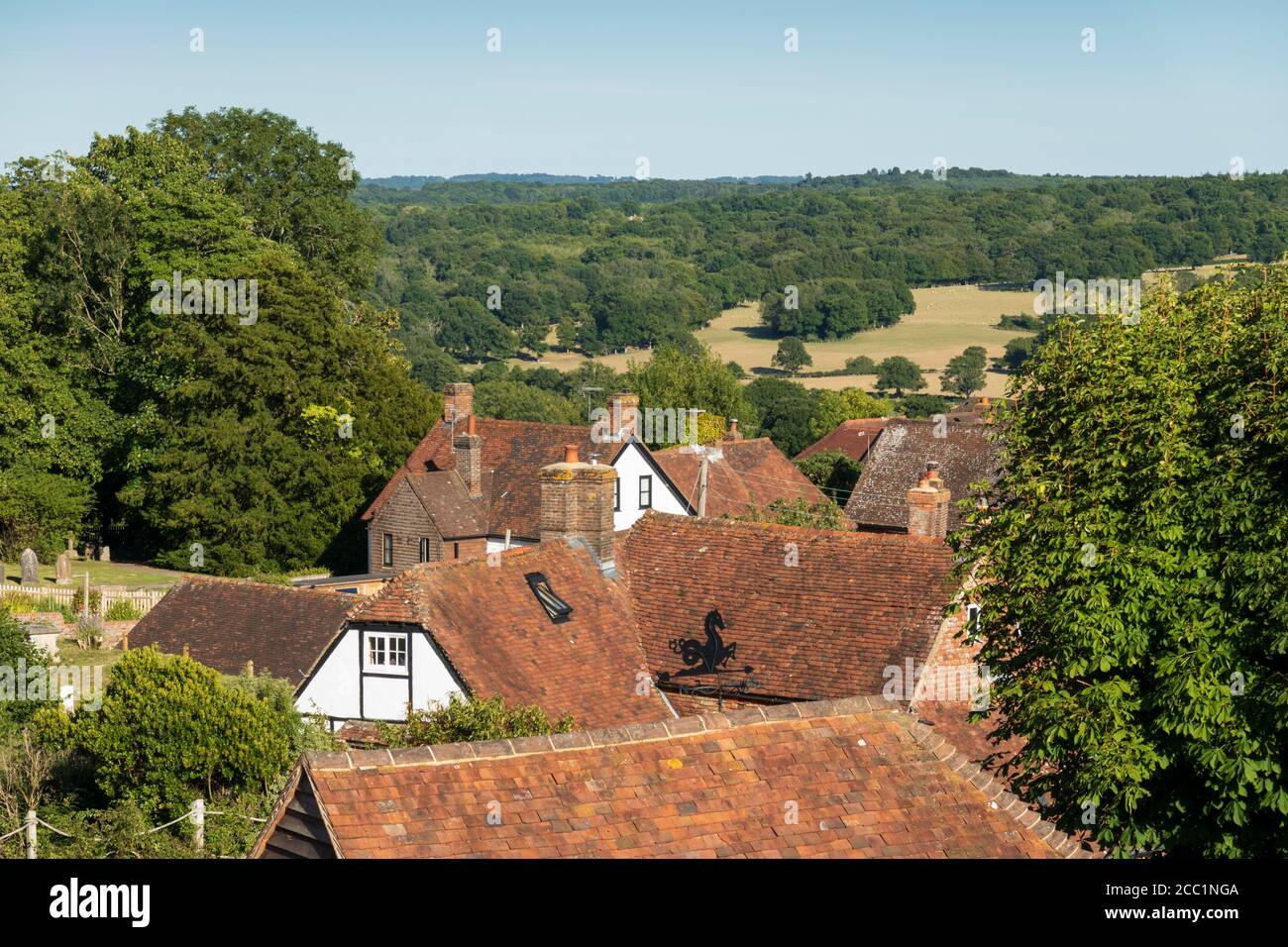 View over cottage rooftops and High Weald landscape in summer, Burwash, East Sussex, England, United Kingdom, Europe Stock Photo