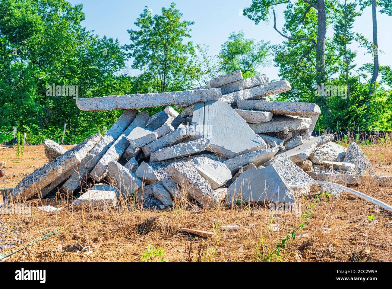 https://c8.alamy.com/comp/2CC2W99/horizontal-shot-of-a-pile-of-broken-concrete-slab-pieces-2CC2W99.jpg