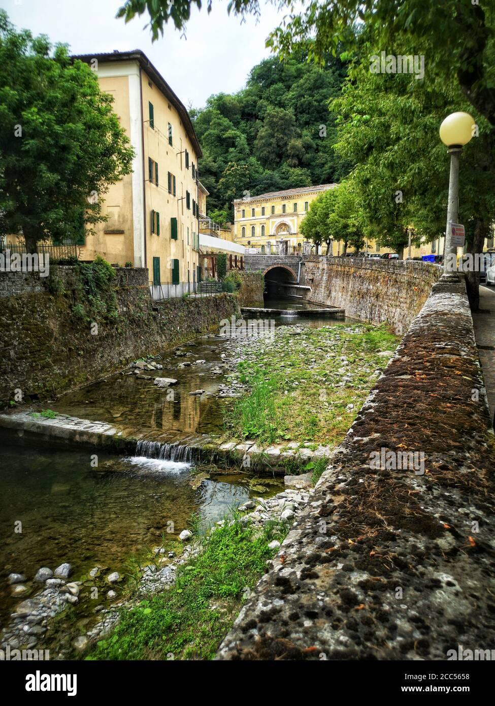 vertical river in italy town village of Porretta near Bologna in Emilia Romagna Stock Photo