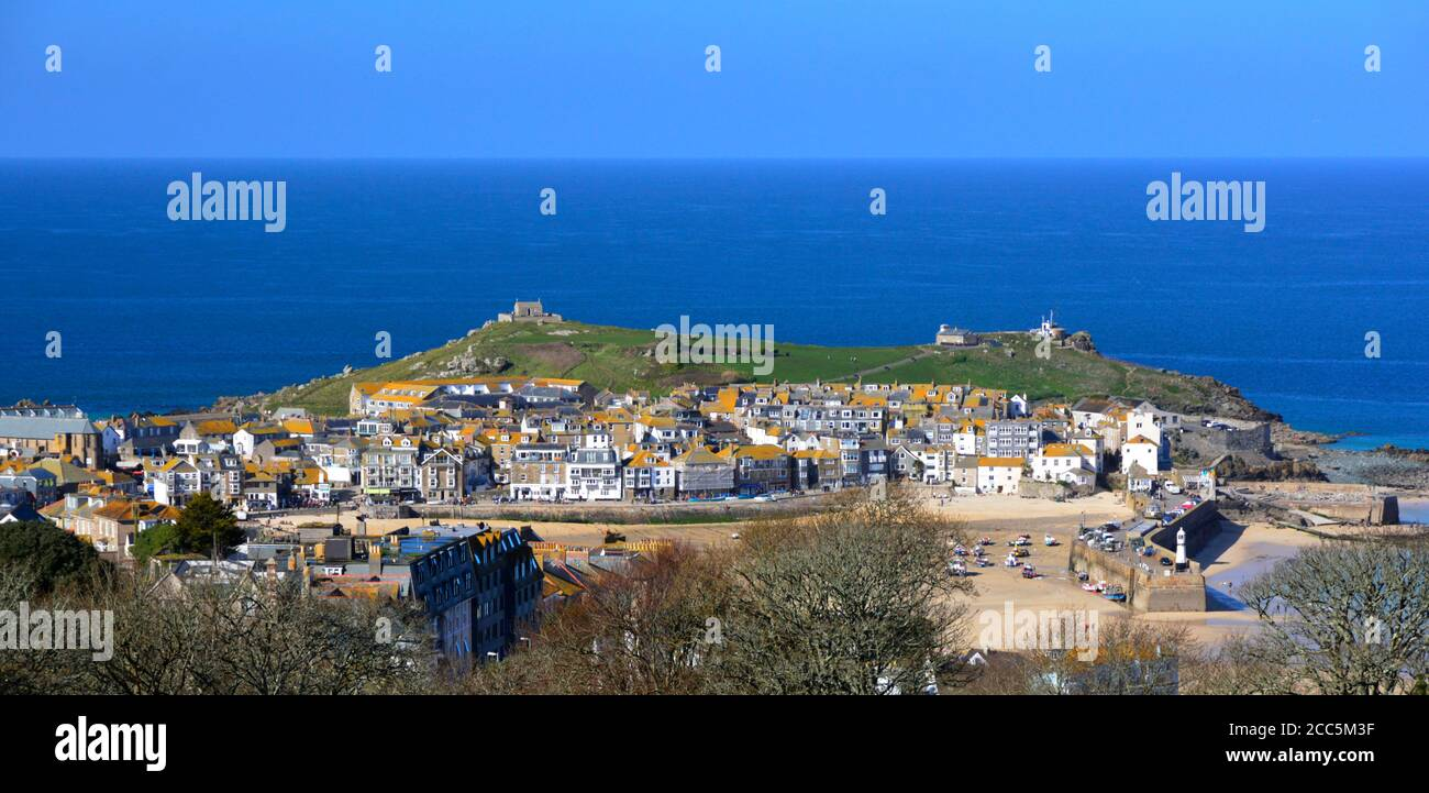 St Ives fishing harbour with the Island in the background. Whilst known as the Island, it is in fact a peninsula Stock Photo