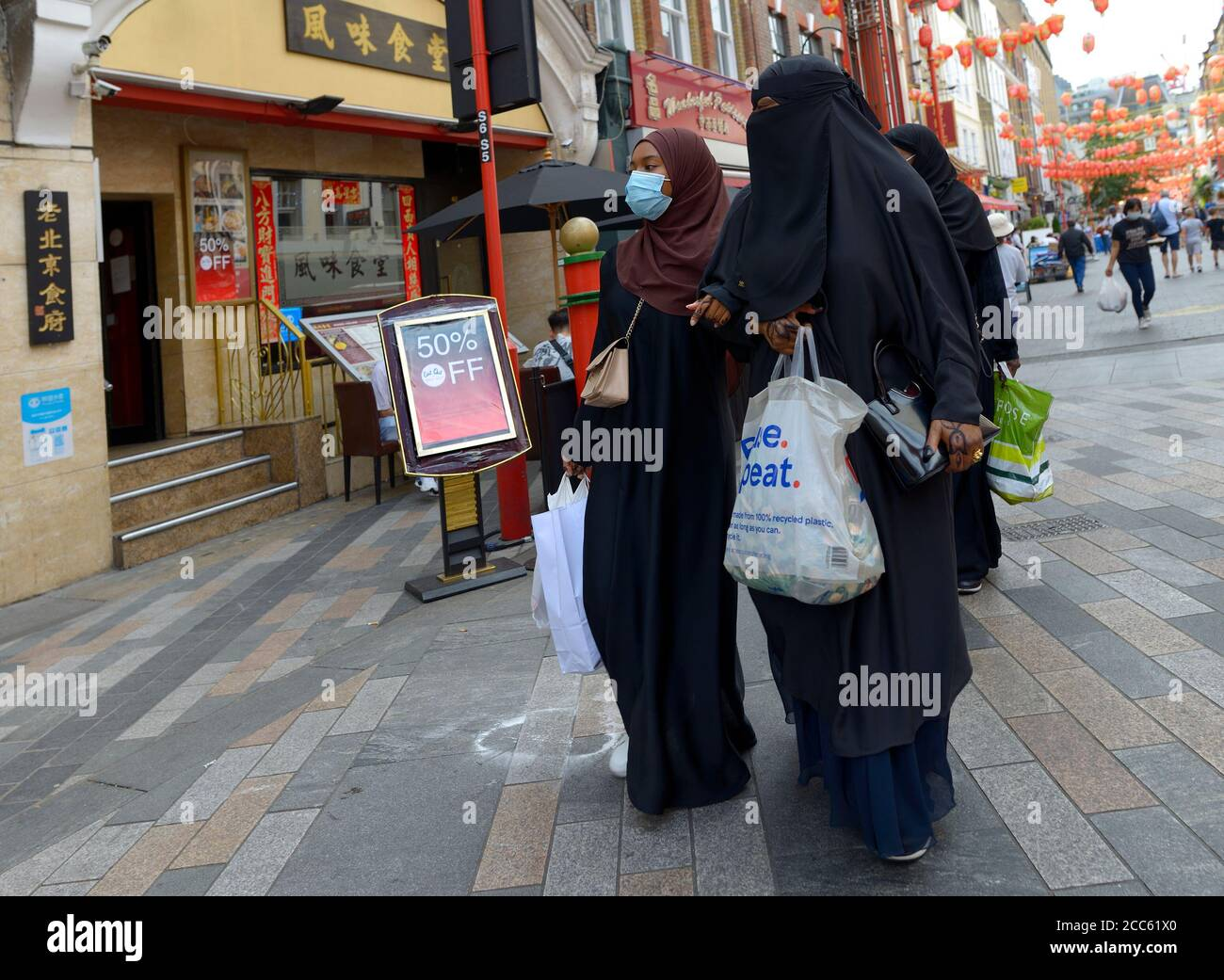 London, England, UK. Muslim women with face coverings in Gerrard Street, Chinatown, during the COVID pandemis, August 2020. Stock Photo