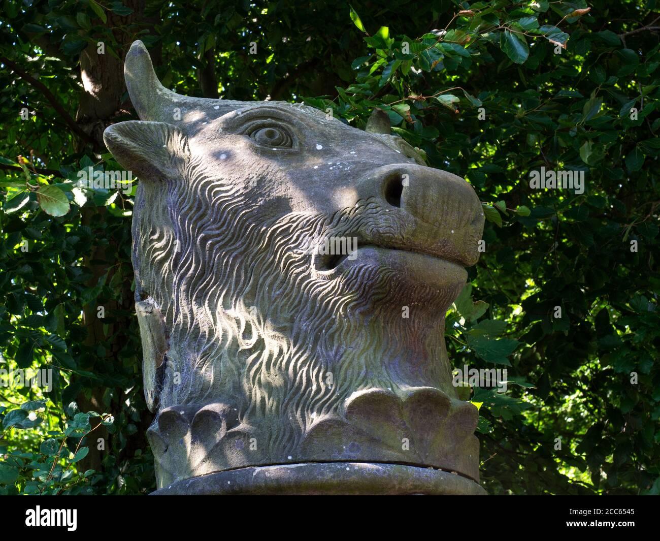 Bulls Head sculpture surmounting a gate pier at the Rudding Dower entrance to Rudding Park Estate near Harrogate North Yorkshire England Stock Photo