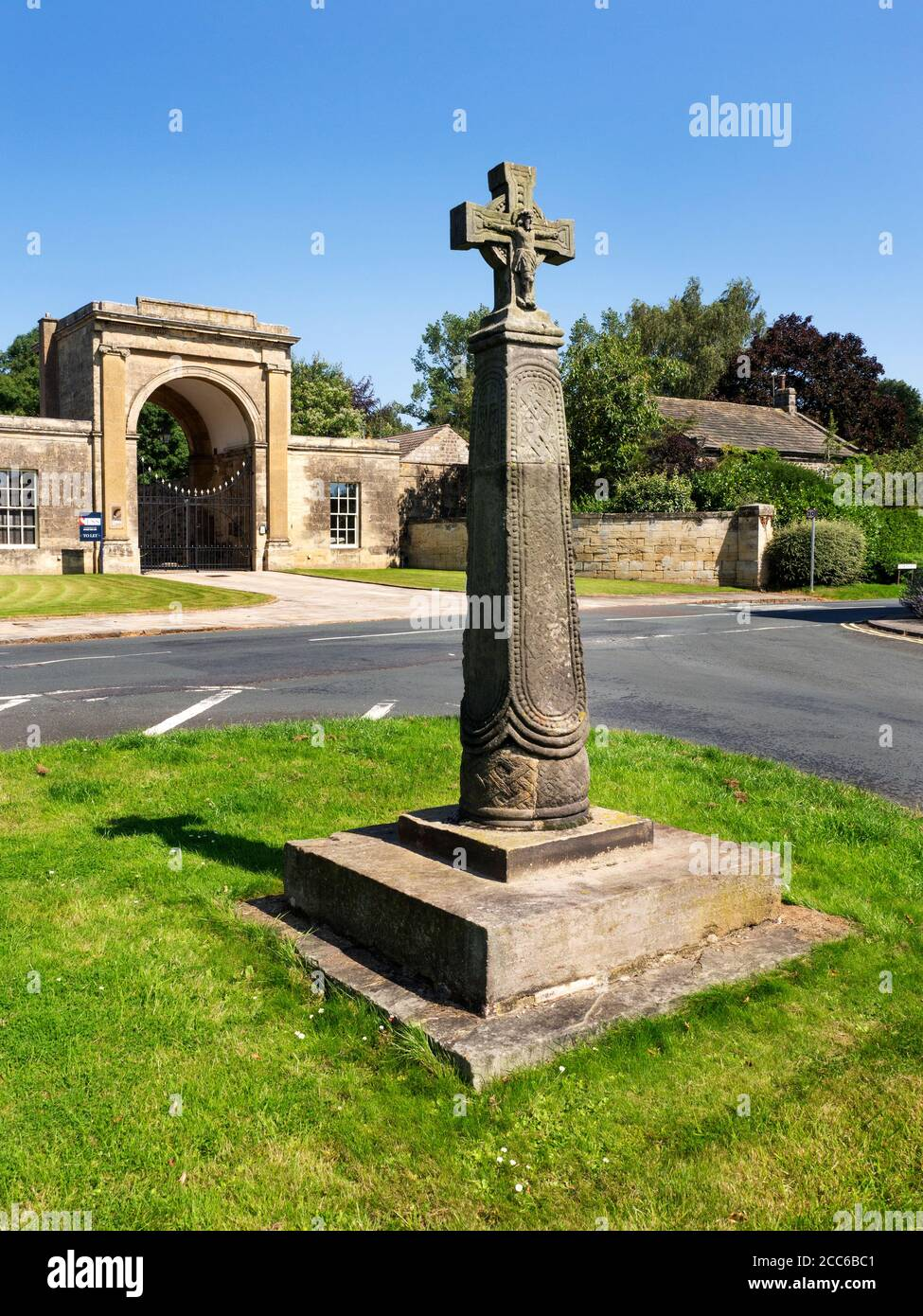 Saxon Cross and Rudding Gates former entrance to Rudding Park Estate in Follifoot near Harrogate North Yorkshire England Stock Photo