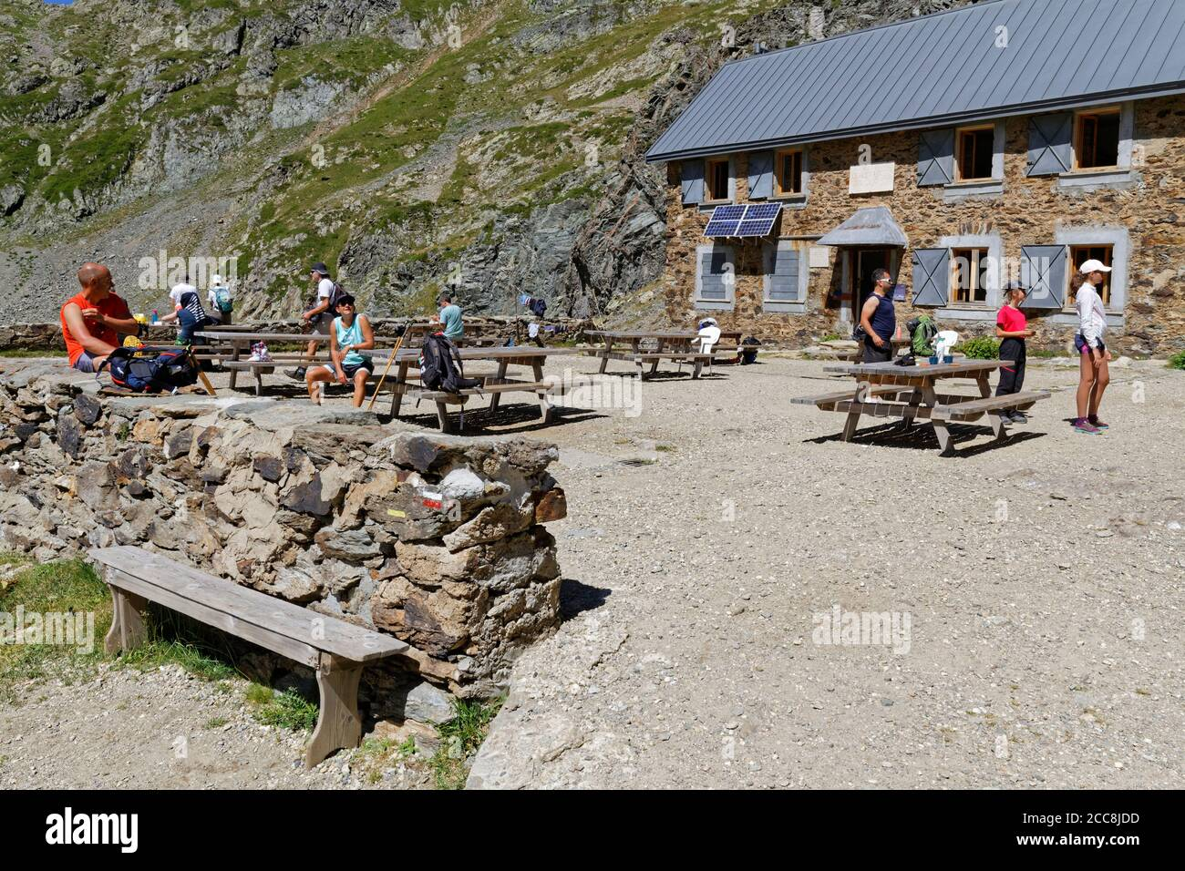 LA PRA, FRANCE, August 6, 2020 : A group of hikers rest for a while at the mountain refuge, with social distanciation respect. Stock Photo