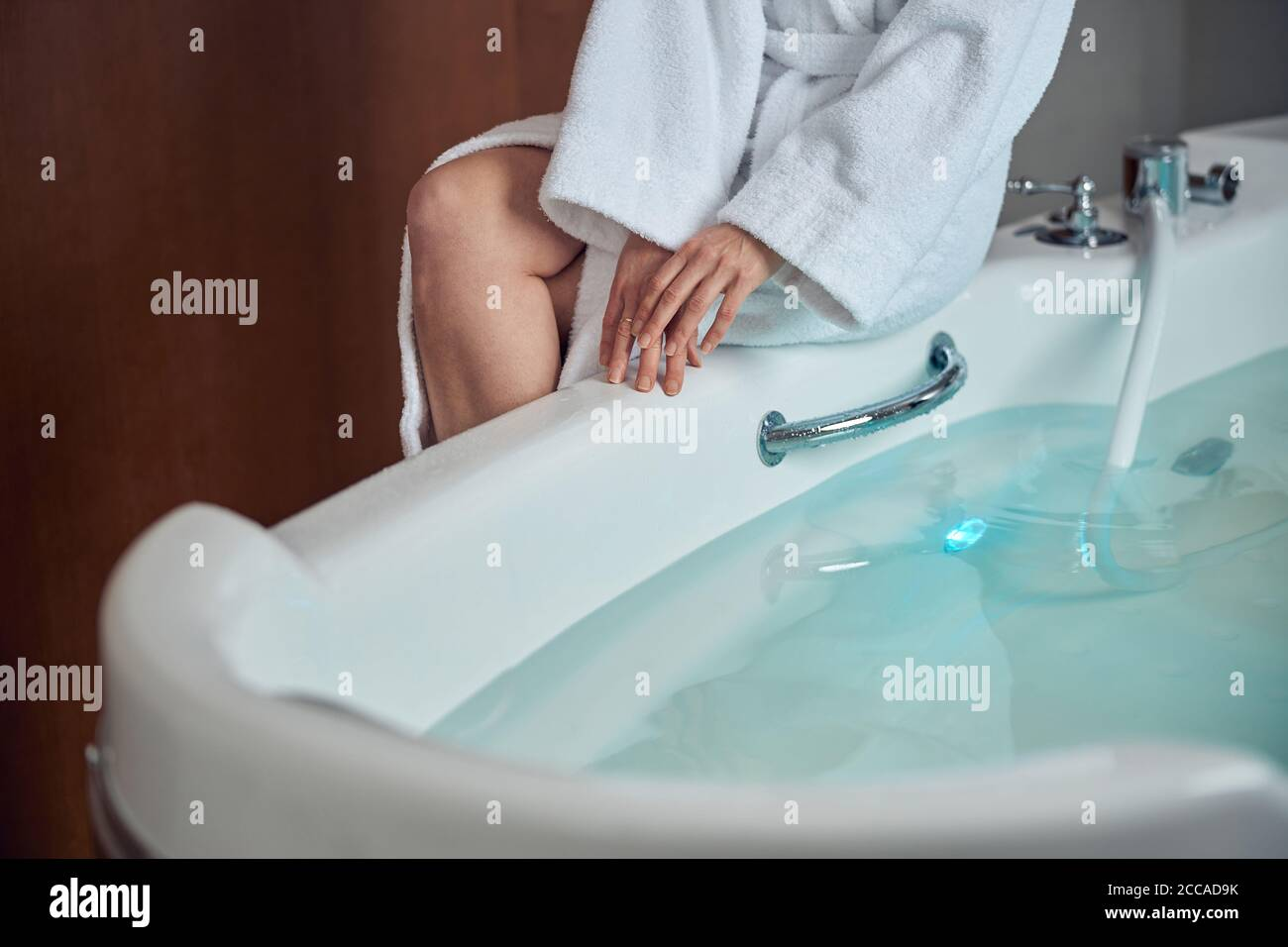 Woman getting ready for a water procedure Stock Photo