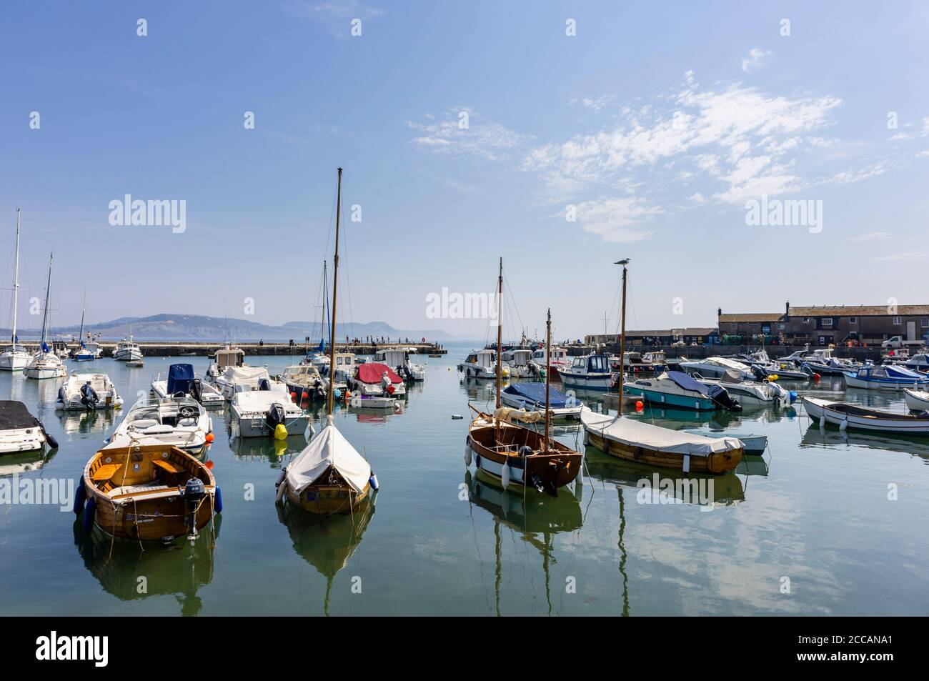 Sailing and motor boats moored at the Cobb in Lyme Regis, a popular seaside town holiday resort on the Jurassic Coast in Dorset, south-west England Stock Photo