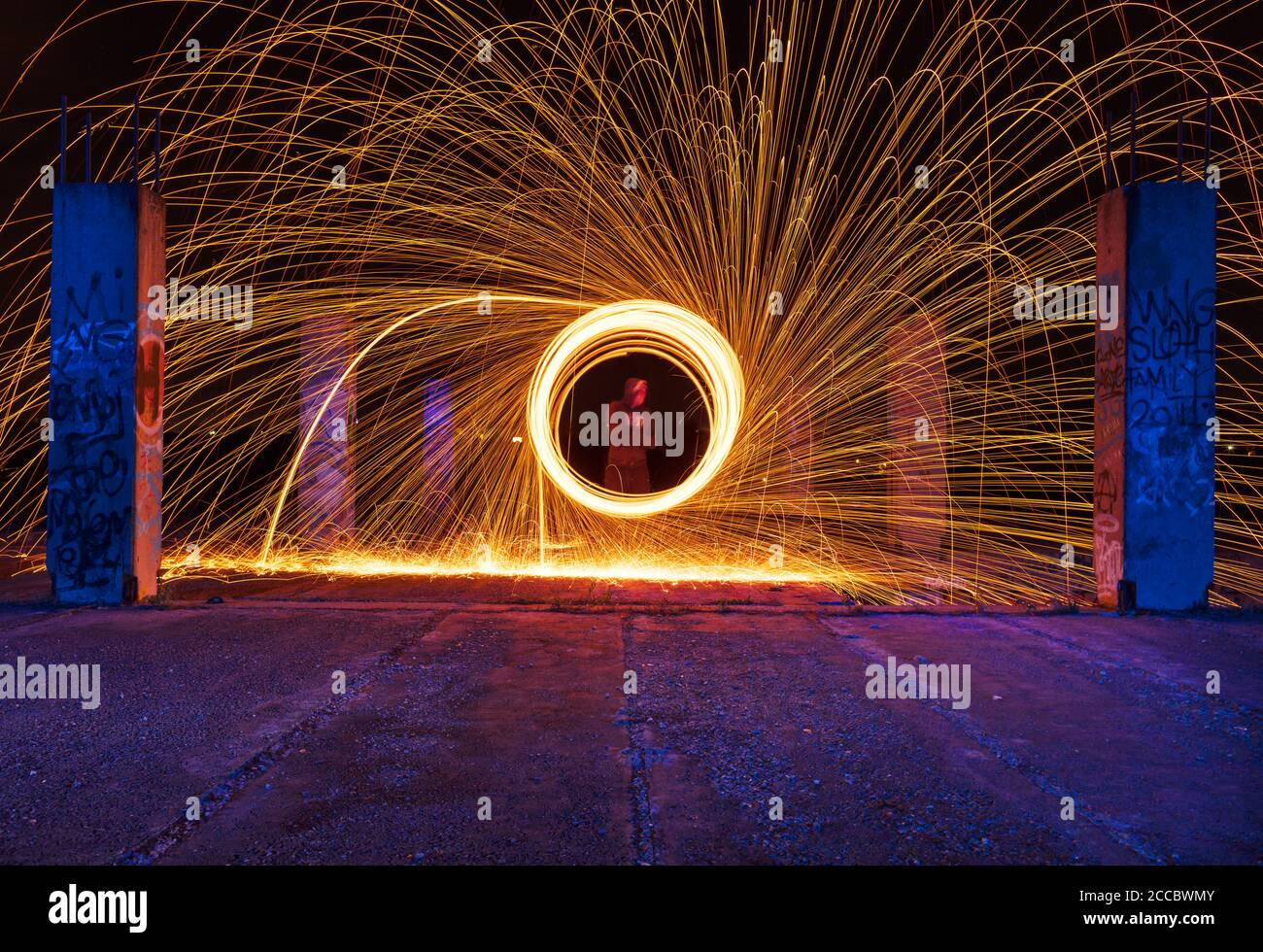 Steel wool fire photography shot on long exposure, making abstract shapes. Stock Photo