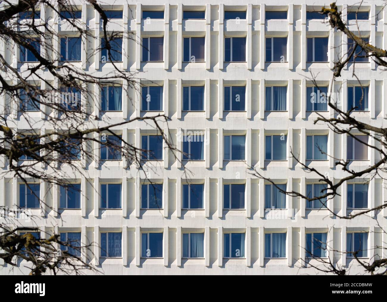Elements of architecture of buildings, windows texture, arches, frames and niches. On the streets in Minsk, public places. Stock Photo