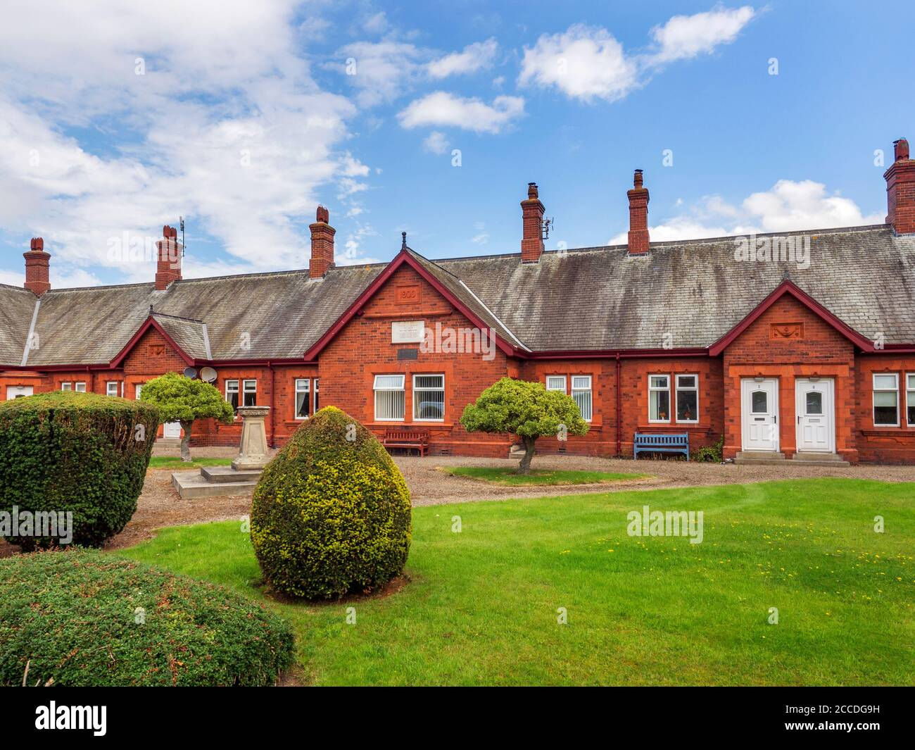 Old almshouses at the village of Nidd near Harrogate North Yorkshire England Stock Photo