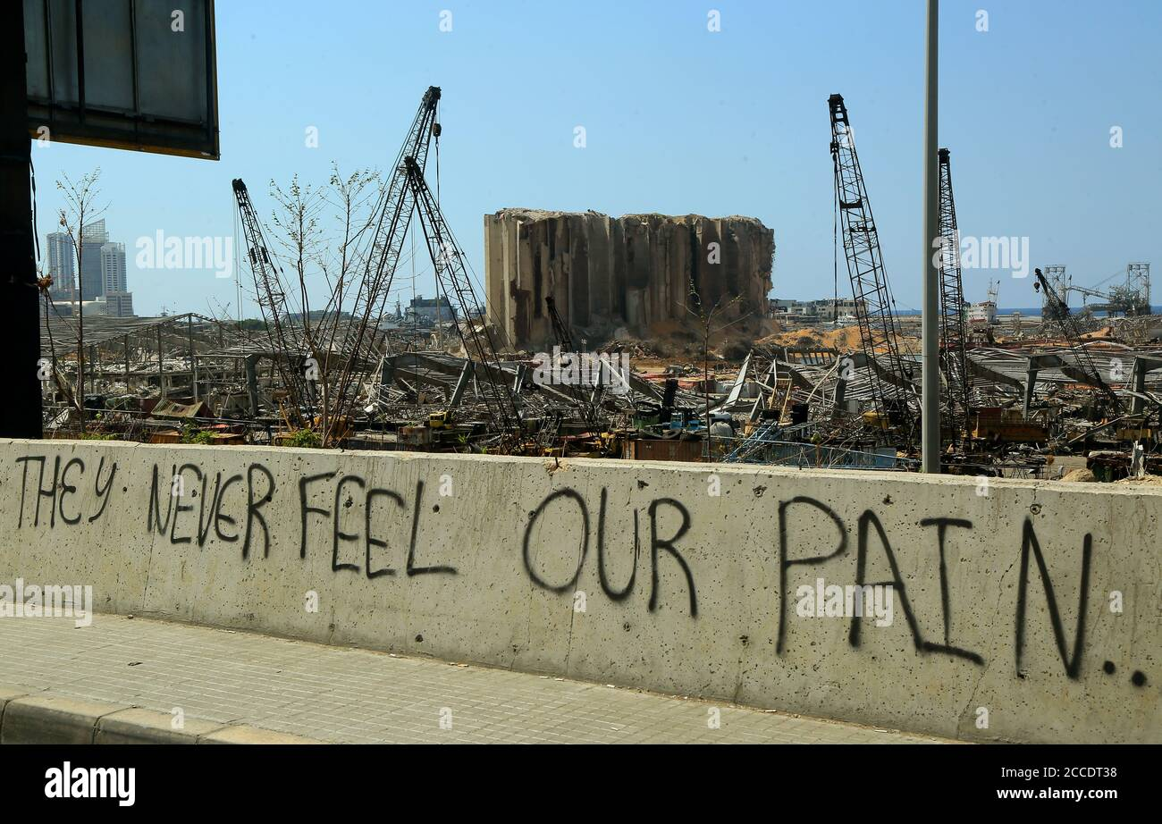 """Beirut, Lebanon. 21st Aug, 2020. """"They never feel our pain"""" is seeen written on a wall at the site of the massive Beirut port explosion of 04 August. More than two weeks after the blast that rocked the Lebanese capital some residents started returning home for cleanup, repair and to try to go back to their normal lives. Credit: Marwan Naamani/dpa/Alamy Live News Stock Photo"""