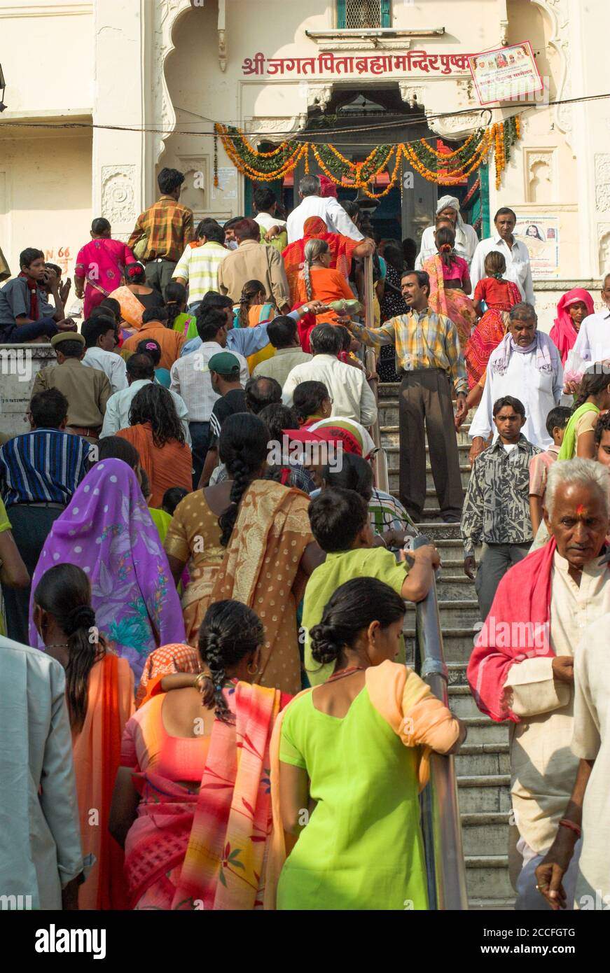 Hindu pilgrims crowd into the Brahma Temple at Pushkar, Rajasthan, during the annual Camel Fair Stock Photo