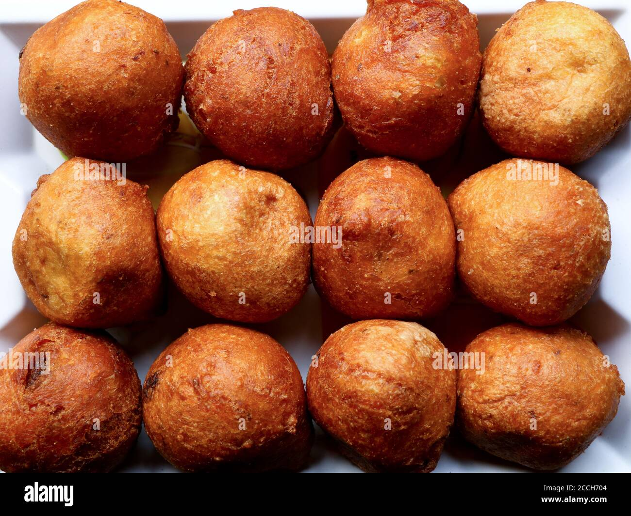 Bonda, a traditional Kerala tea time snack made of maida or wheat flour and jaggery , south Indian cuisine Stock Photo