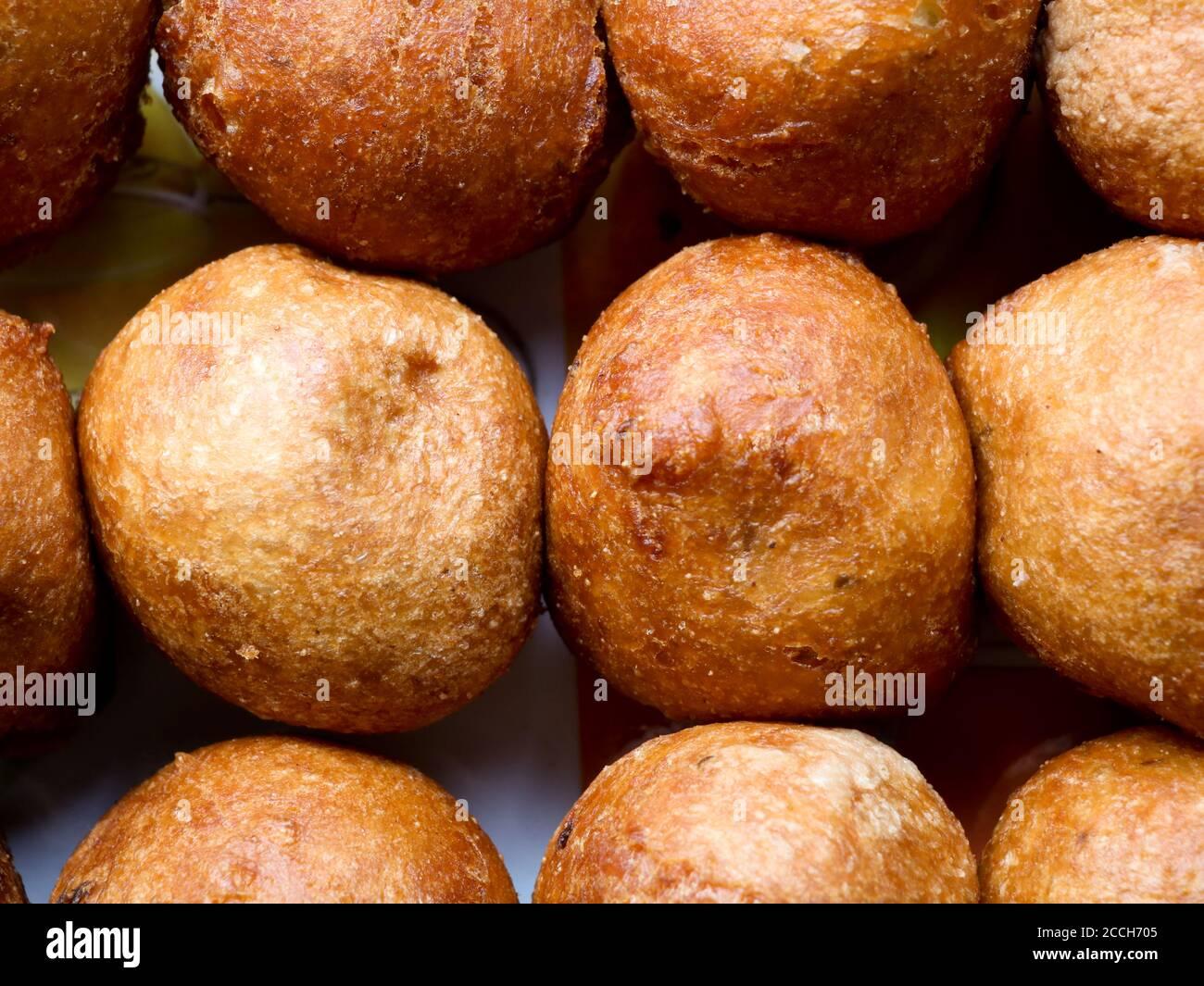 Bonda, a traditional Kerala tea time snack made of maida or wheat flour and jaggery , south Indian cuisine Stock Photo