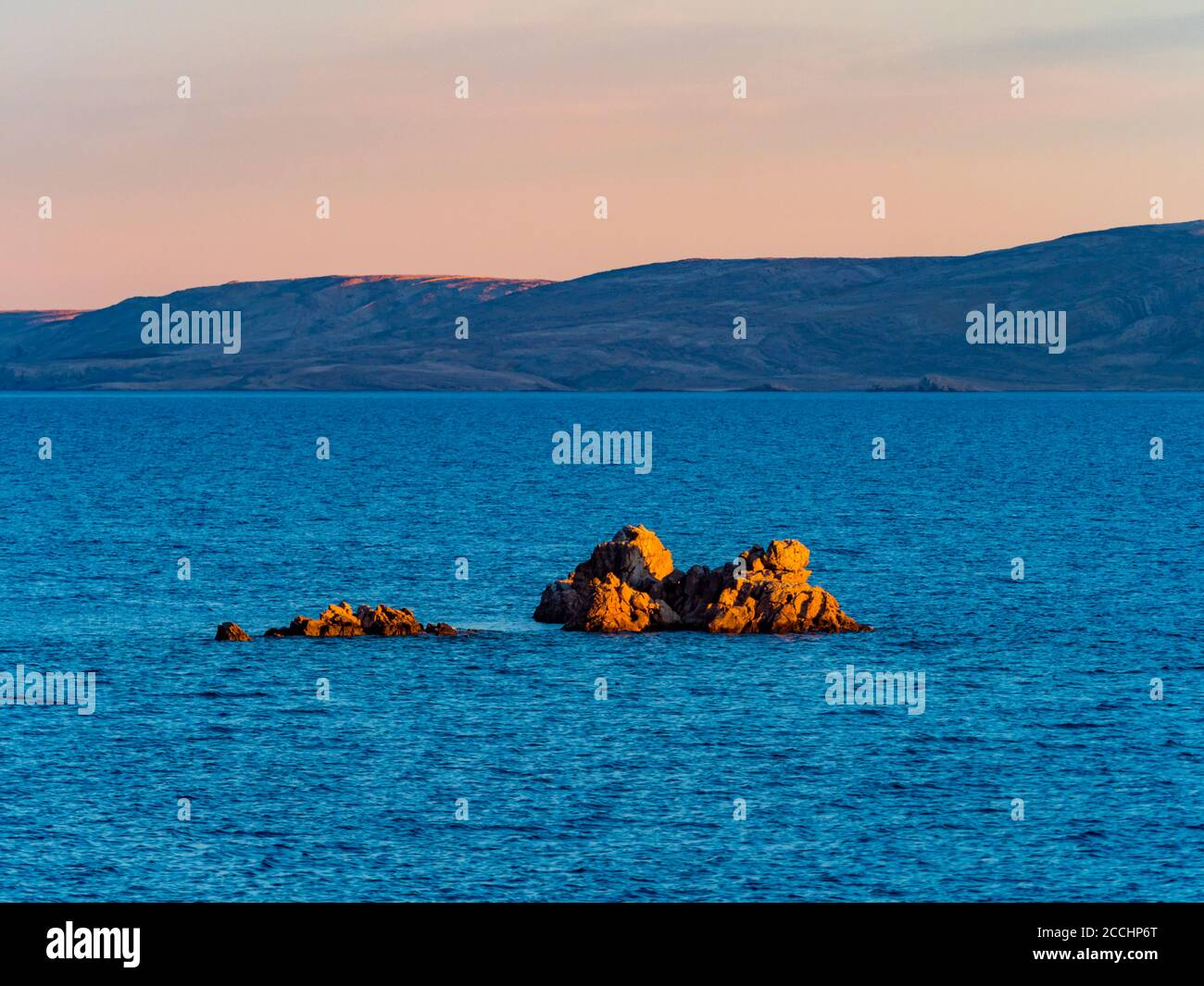 Evening scenery lonely small tiny rocky island before Ribarica near Karlobag in Croatia Europe Stock Photo