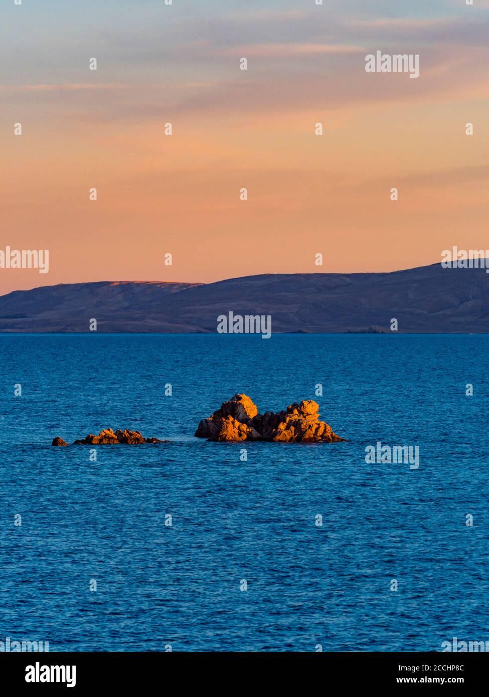 Evening scenery lonely small tiny rocky island before Ribarica near Karlobag in Croatia Europe Stock Photo