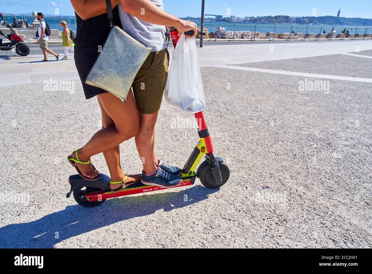 Lisbon, Lissabon, Portugal, 16rd August 2020.  A couple driving together on an e-scooter on Praca do Comercio. © Peter Schatz / Alamy Stock Photos Stock Photo