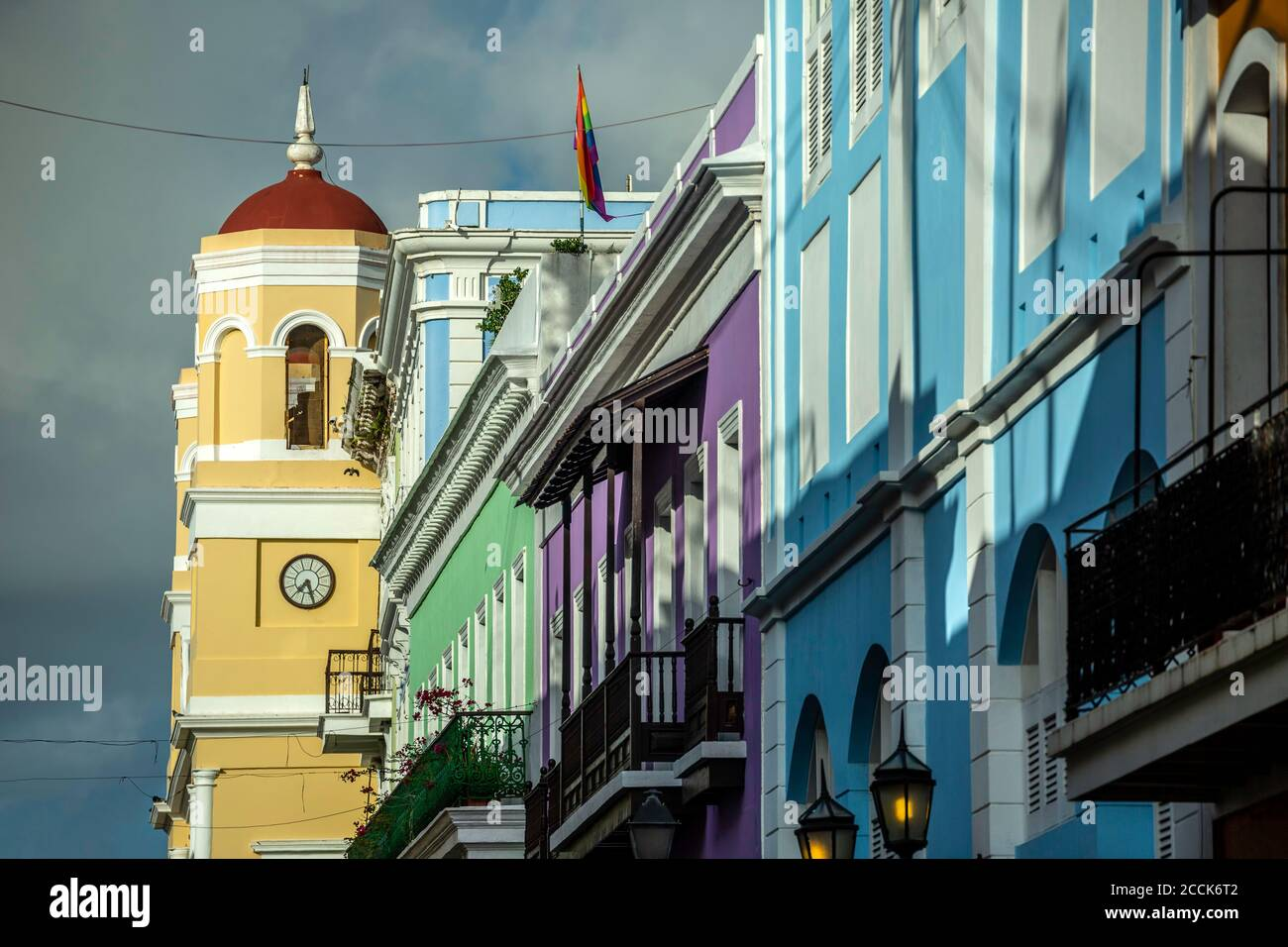 City Hall bell tower and colorful Spanish Colonial buildings, San Francisco St., Old San Juan, Puerto Rico Stock Photo