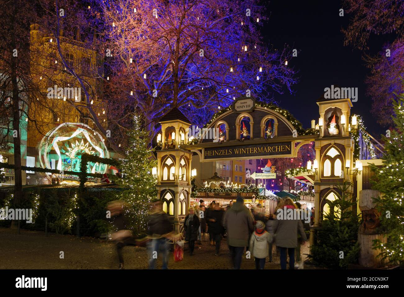 Night scenery, beautiful arched entrance of Weihnachtsmarkt, Christmas Market in Köln, at Alter Markt, famous marketplace nearby Cologne city hall. Stock Photo