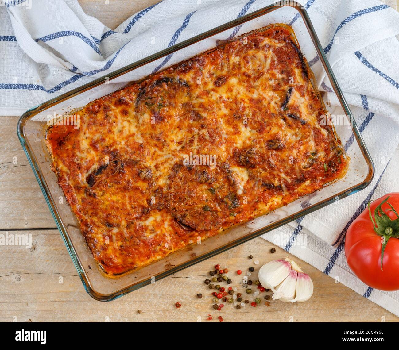 Baked Aubergine Slices With Tomato Sauce Cheese Parmesan Mozzarella Garlic Basil And Spices Eggplant Parmigiana Traditional Italian Dish Sele Stock Photo Alamy
