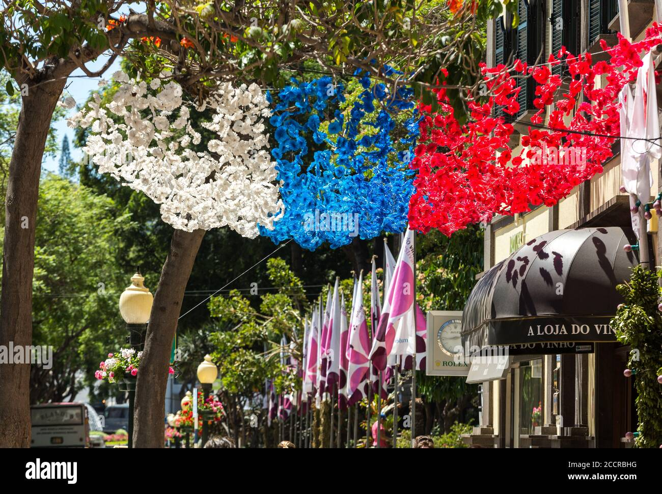 FUNCHAL, MADEIRA, PORTUGAL - SEPTEMBER 1, 2016: Colorful decorations  from garlands over streets during the Madeira Wine Festival in Funchal on Madeir Stock Photo