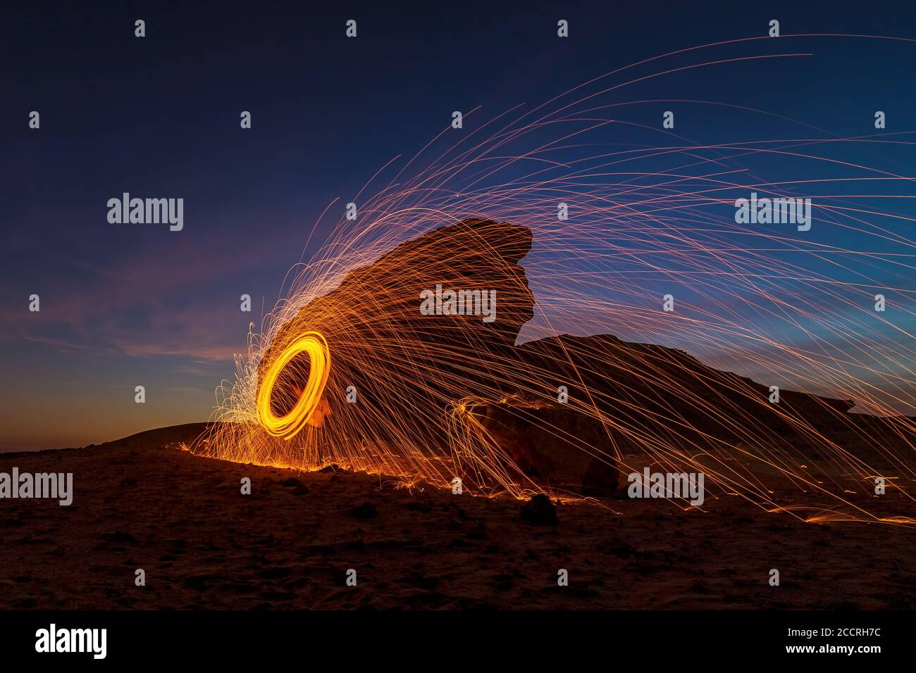 A steel wool on fire at night (night photography using a slow shutter speed) - selective focused on the subject. Stock Photo