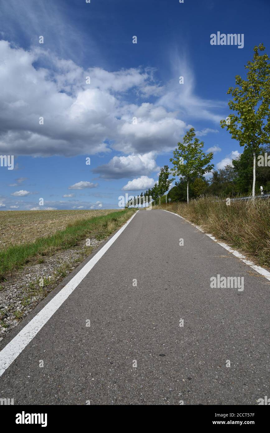 A road leading towards the clouds Stock Photo