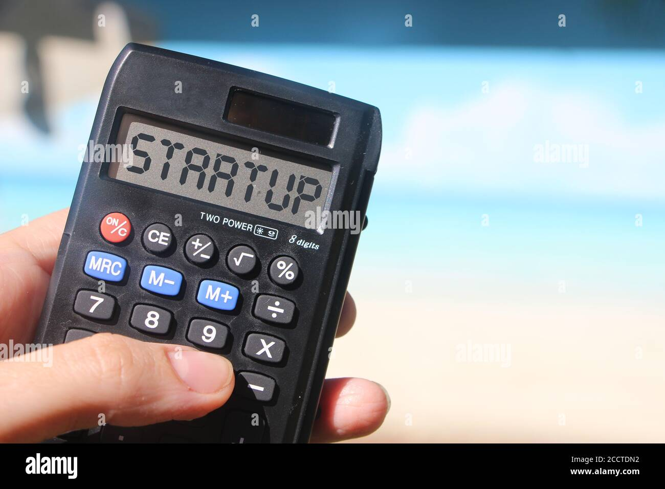 Word Startup On Calculator Display Beach Landscape New Business Concept Stock Photo Alamy