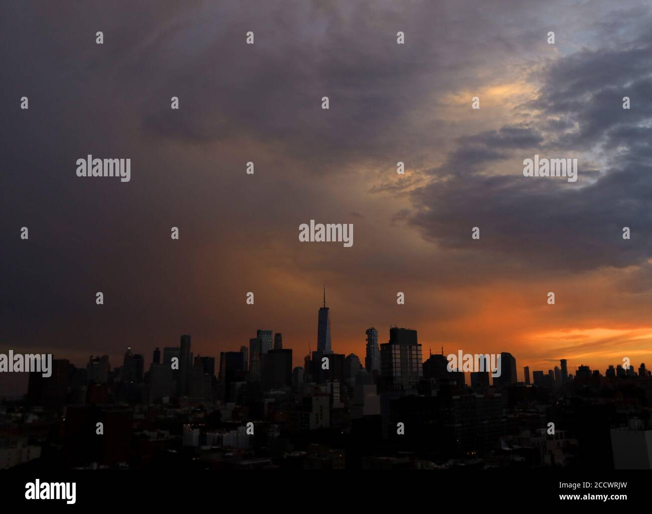 New York, United States. 24th Aug, 2020. The sun sets behind One World Trade Center and the Manhattan Skyline in New York City on Monday, August 24, 2020. Photo by John Angelillo/UPI Credit: UPI/Alamy Live News Stock Photo
