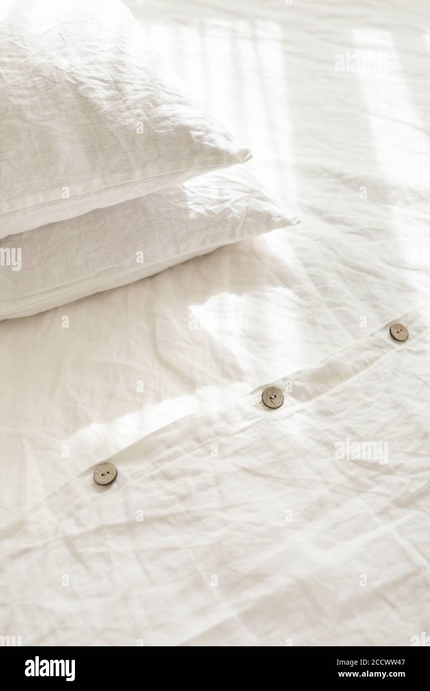 Trendy Organic Natural Linen Bedclothes With Wooden Buttons Closeup Bedding Morning Light Bedroom Style And Design Rough Textile Background With Wrinkle Stock Photo Alamy