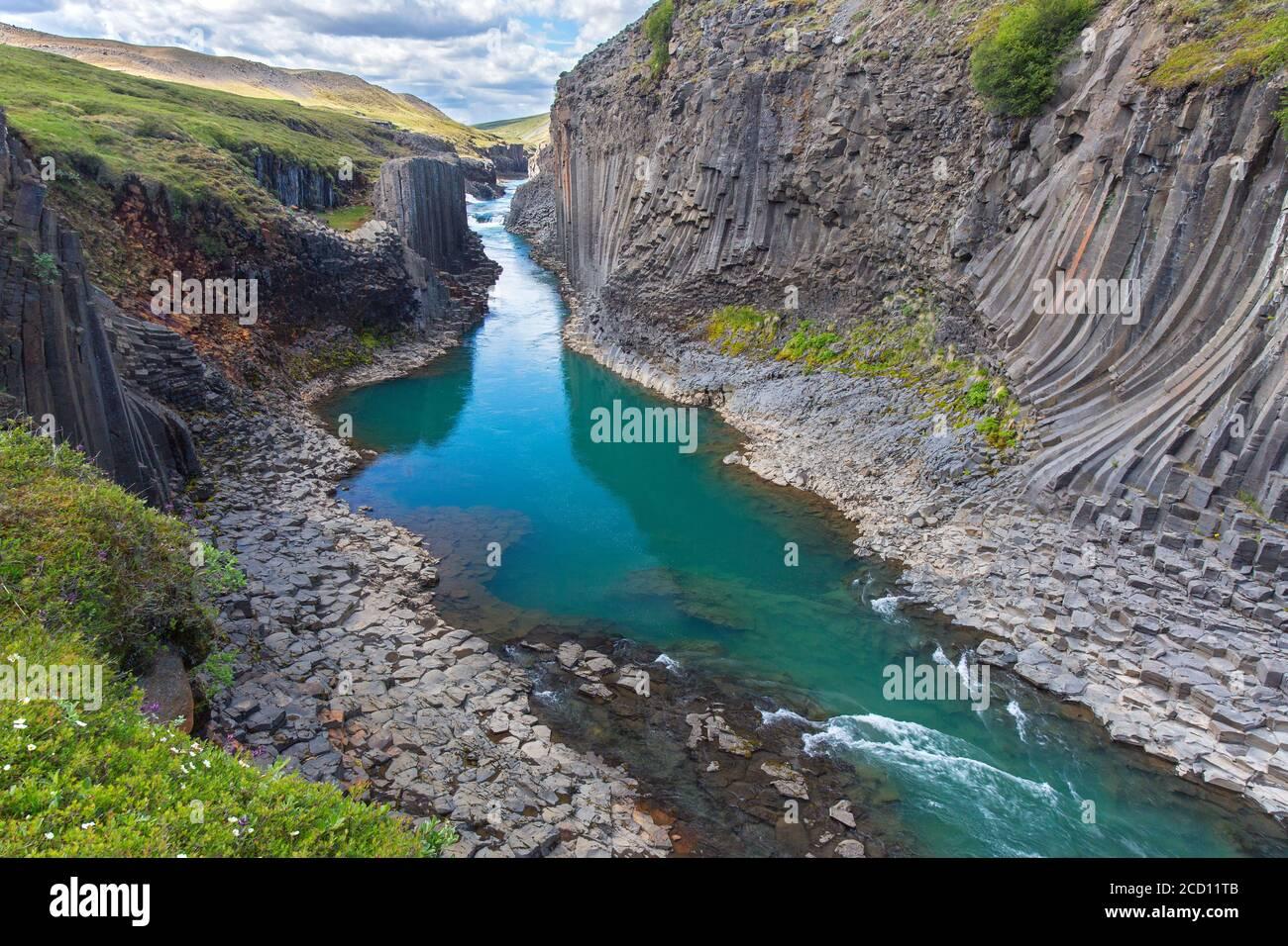 Jökla glacial river and basalt columns, volcanic rock formations at Studlagil / Stuðlagil Canyon, Jökuldalur / Glacier Valley, Austurland, Iceland Stock Photo