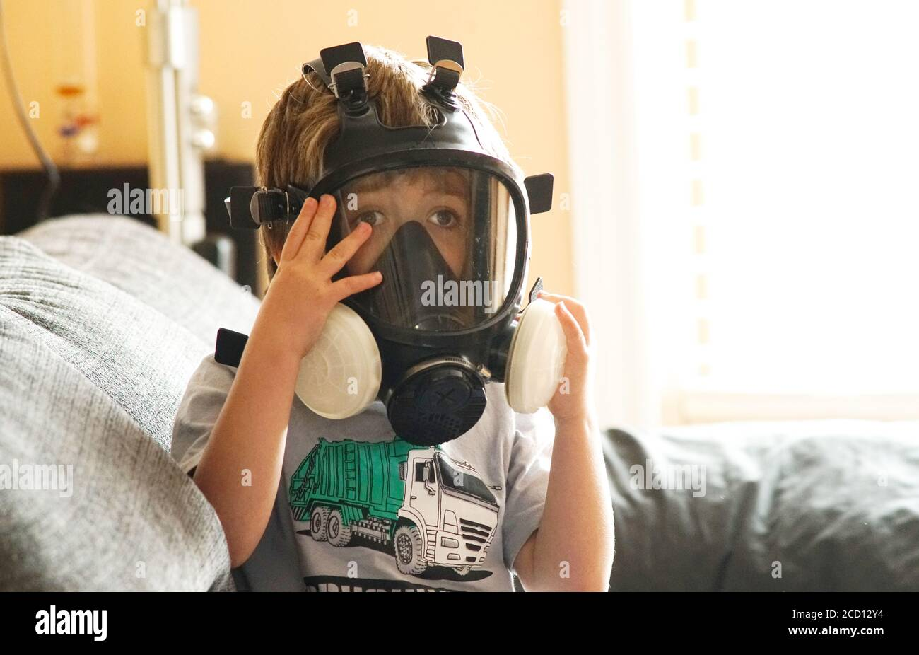 Montreal,Quebec,Canada,August 25, 2020.Young 5 year-old boy wearing. a gas mask.Credit:Mario Beauregard/Alamy News Stock Photo