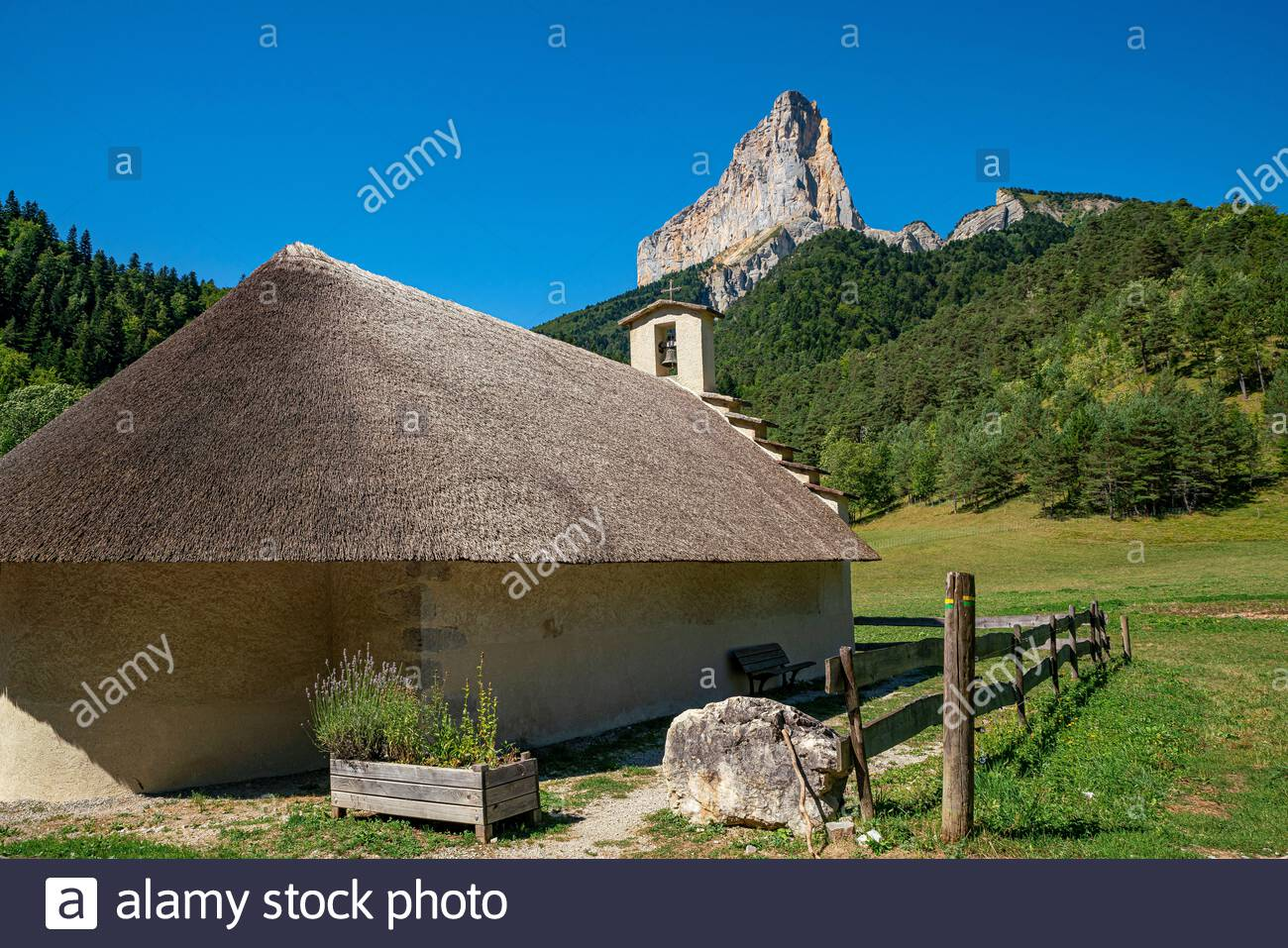 Trézanne thatched-roof Romanesque chapel with the Mont Aiguille in the background, in Vercors Natural Park Stock Photo