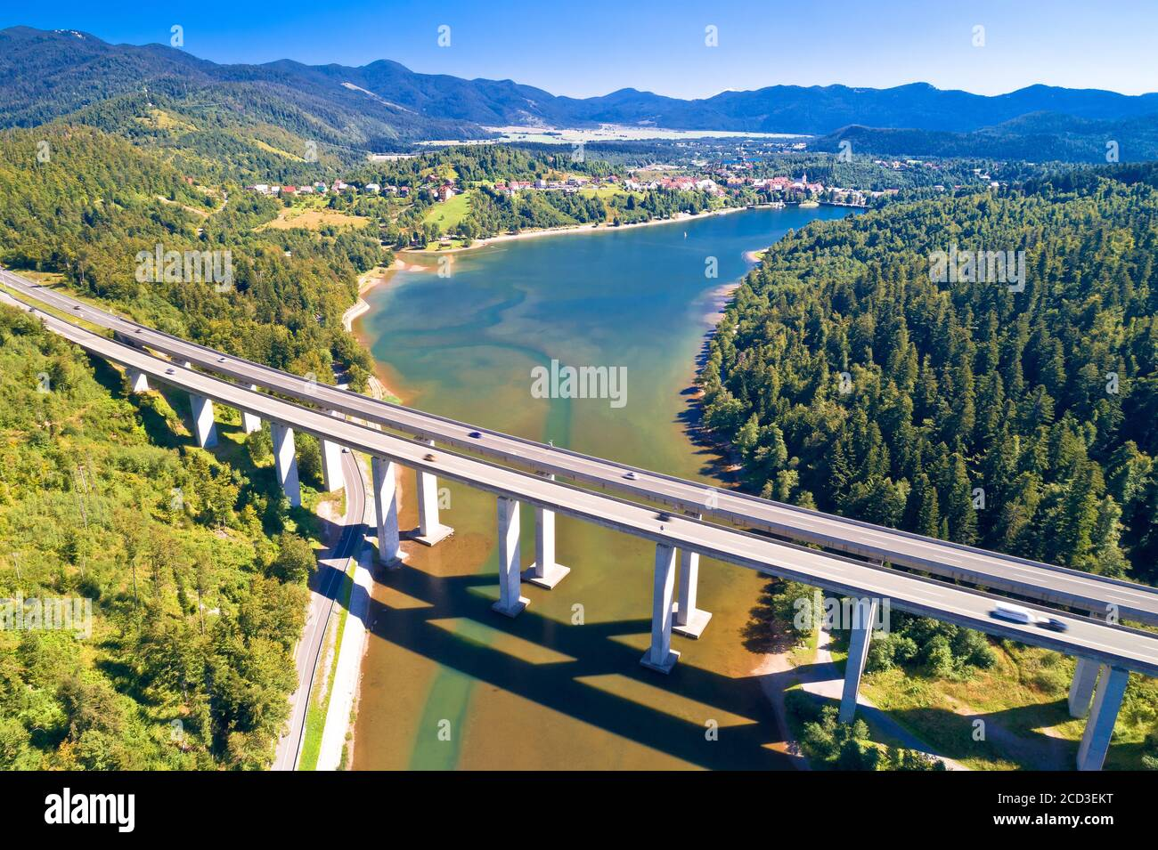 Viaduct Bajer above idyllic lake and town of Fuzine aerial view, Scenic highway A6 in Gorski Kotar region of Croatia, Stock Photo