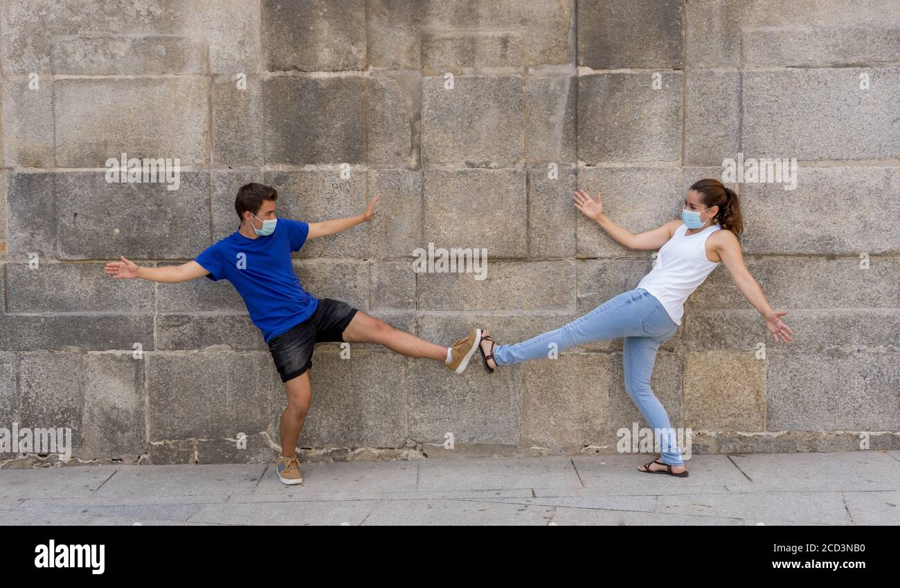 The New Normal and greeting style. Man and woman Shaking elbows or feet keeping social distancing to avoid Coronavirus spread. COVID-19 outbreak and d Stock Photo