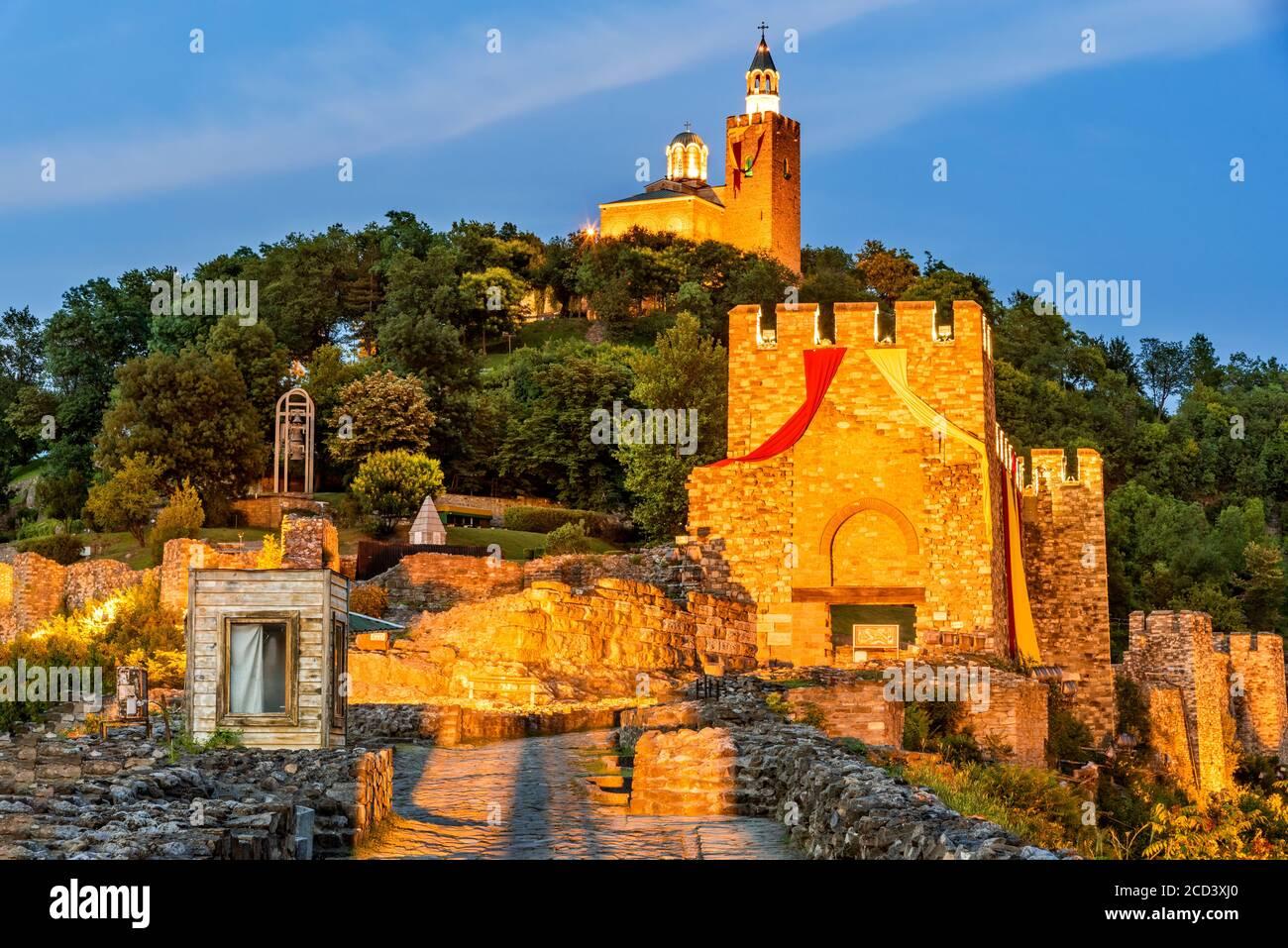 Veliko Tarnovo, Bulgaria. Tsarevets Fortress in in a beautiful summer blue hour light. Stock Photo