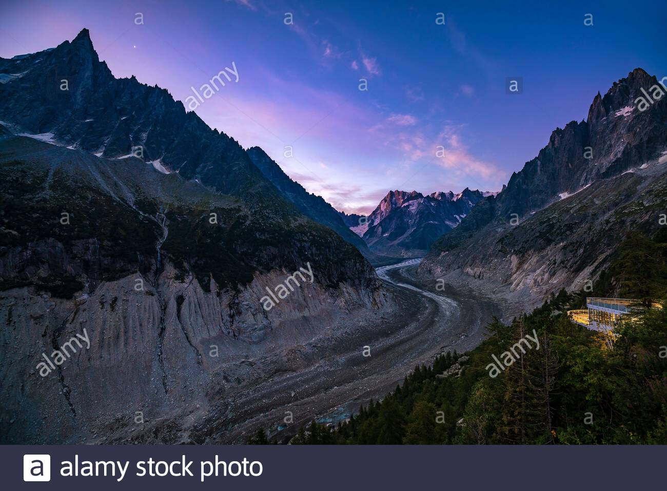 The Aiguille du Dru mountain and the Sea of Ice glace (Mer de Glace), reached by the Montenvers Railway in the Mont Blanc massif near Chamonix Stock Photo