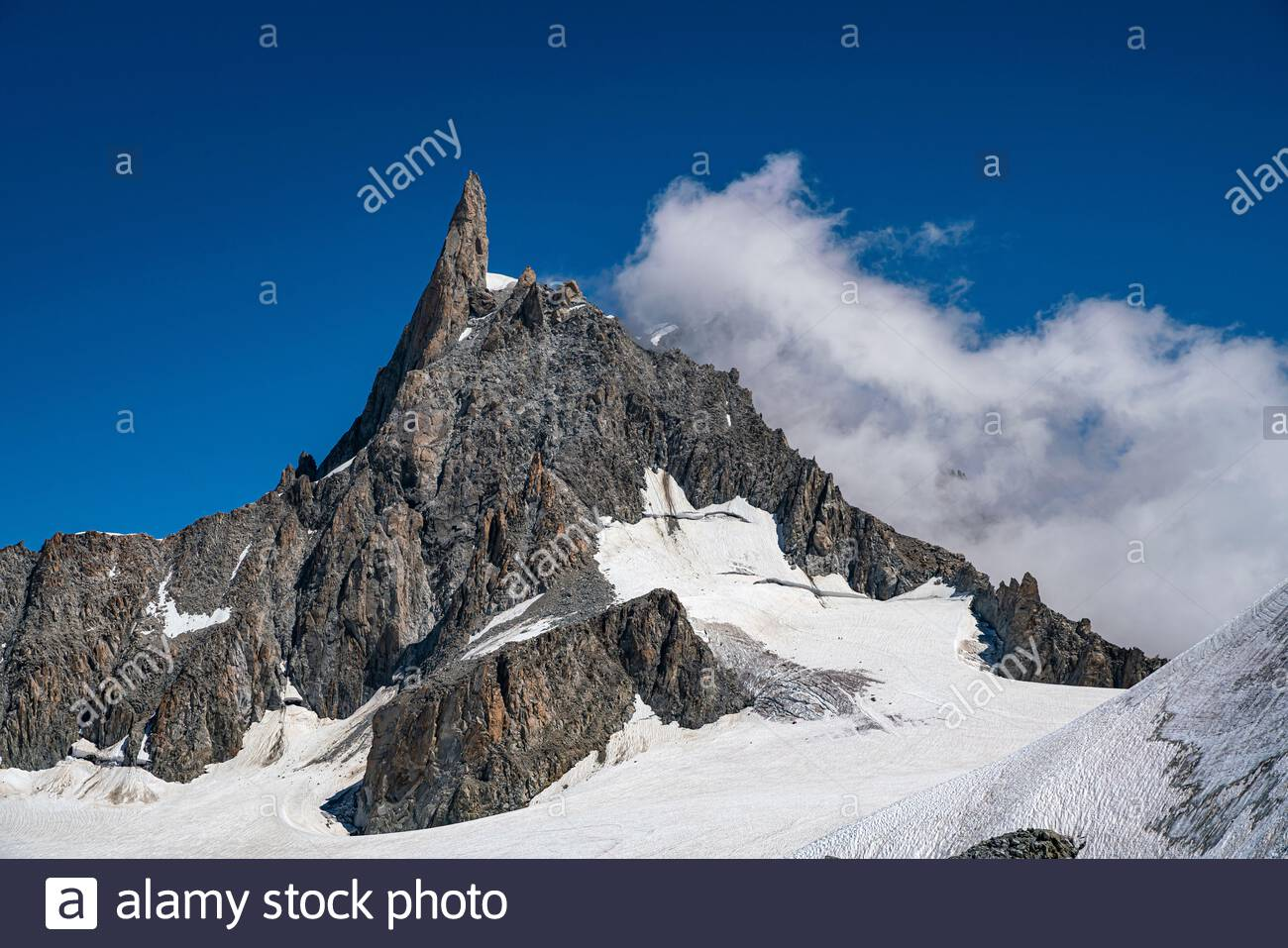 The Dent du Géant or Dente del Gigante (giant's tooth) is a mountain (4,013 m) in the Mont Blanc massif situated between France and Italy. Stock Photo