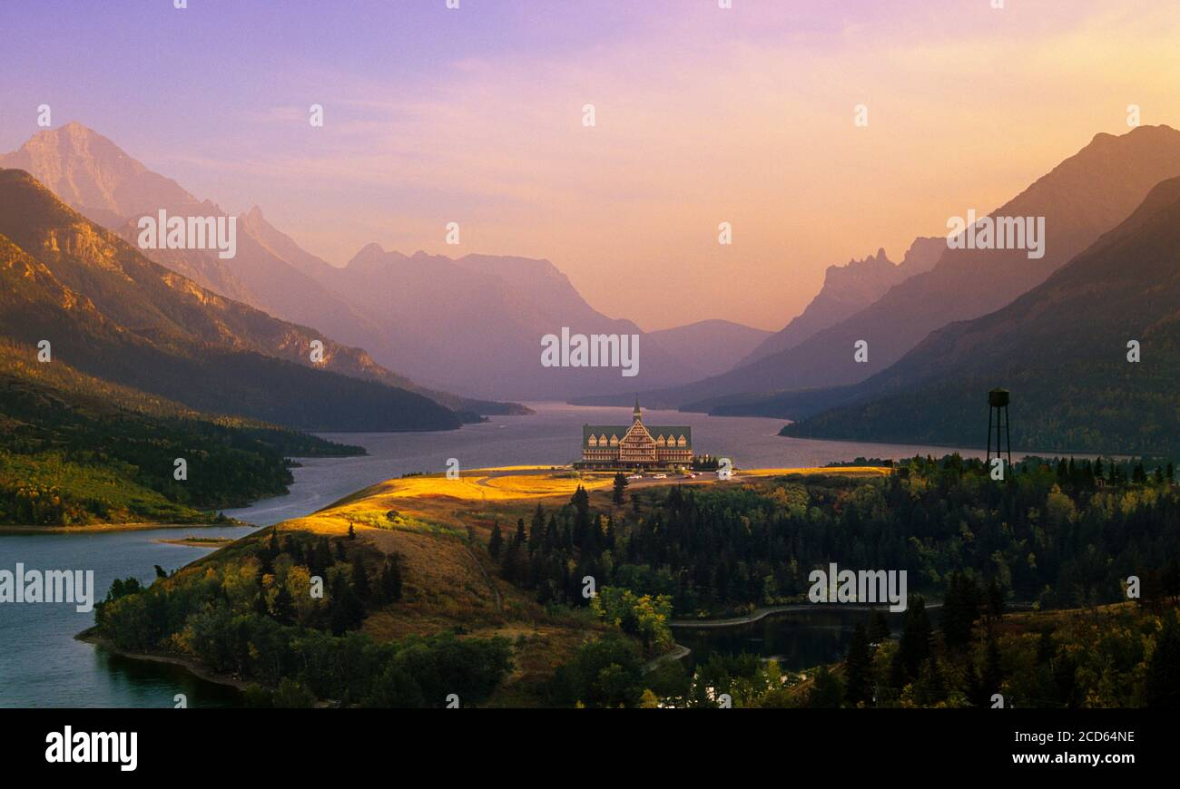 Prince of Wales Hotel on lakeshore at sunset, Waterton Lakes National Park, Alberta, Canada Stock Photo