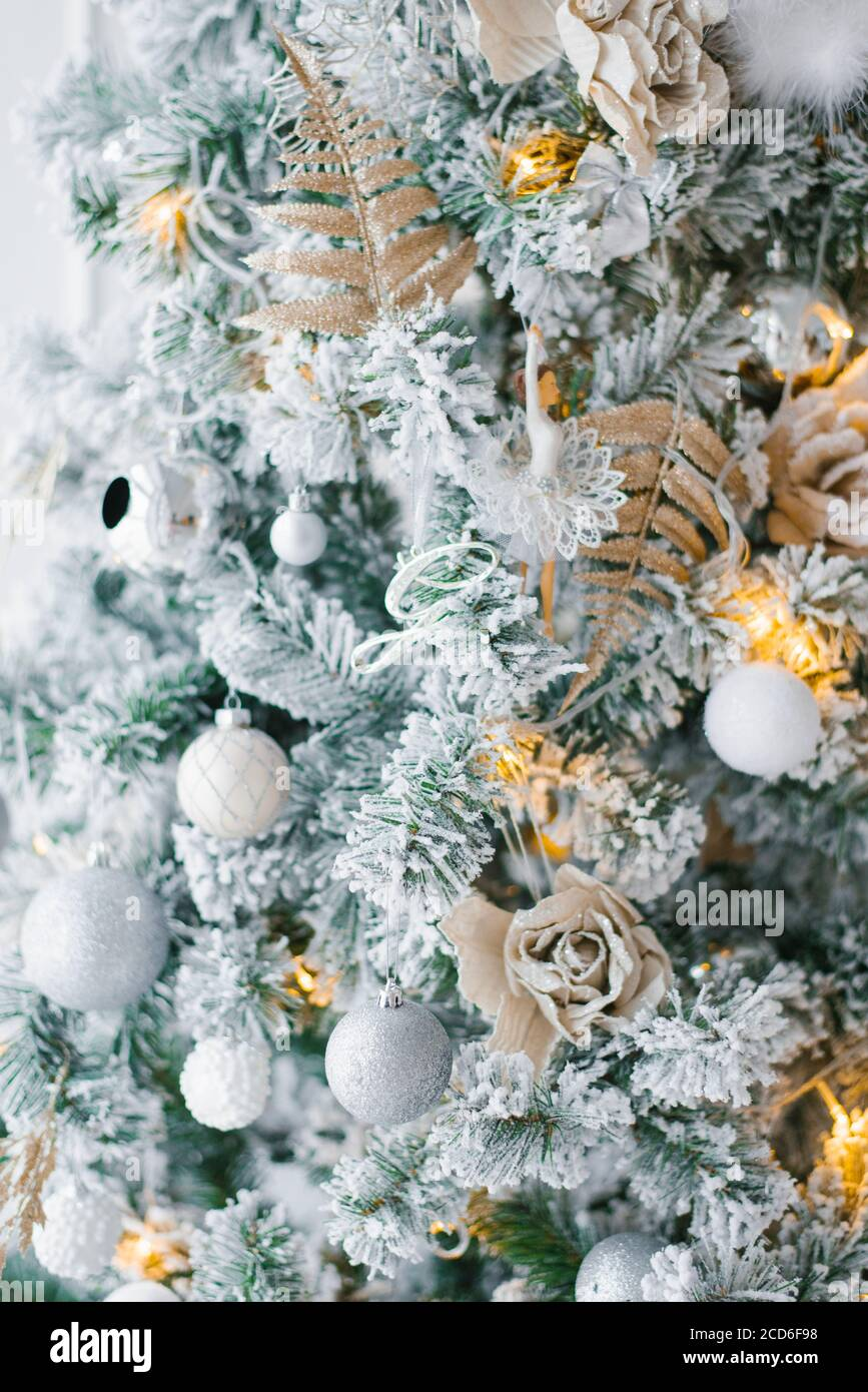 Christmas Tree With White Silver And Gold Toys And Lights Close Up Stock Photo Alamy