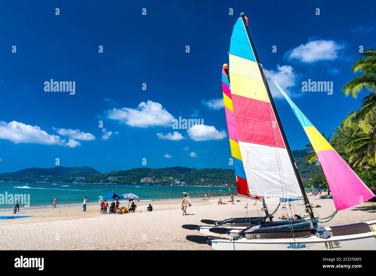 Boats for hire on the beach at Patong, Phuket, Thailand Stock Photo