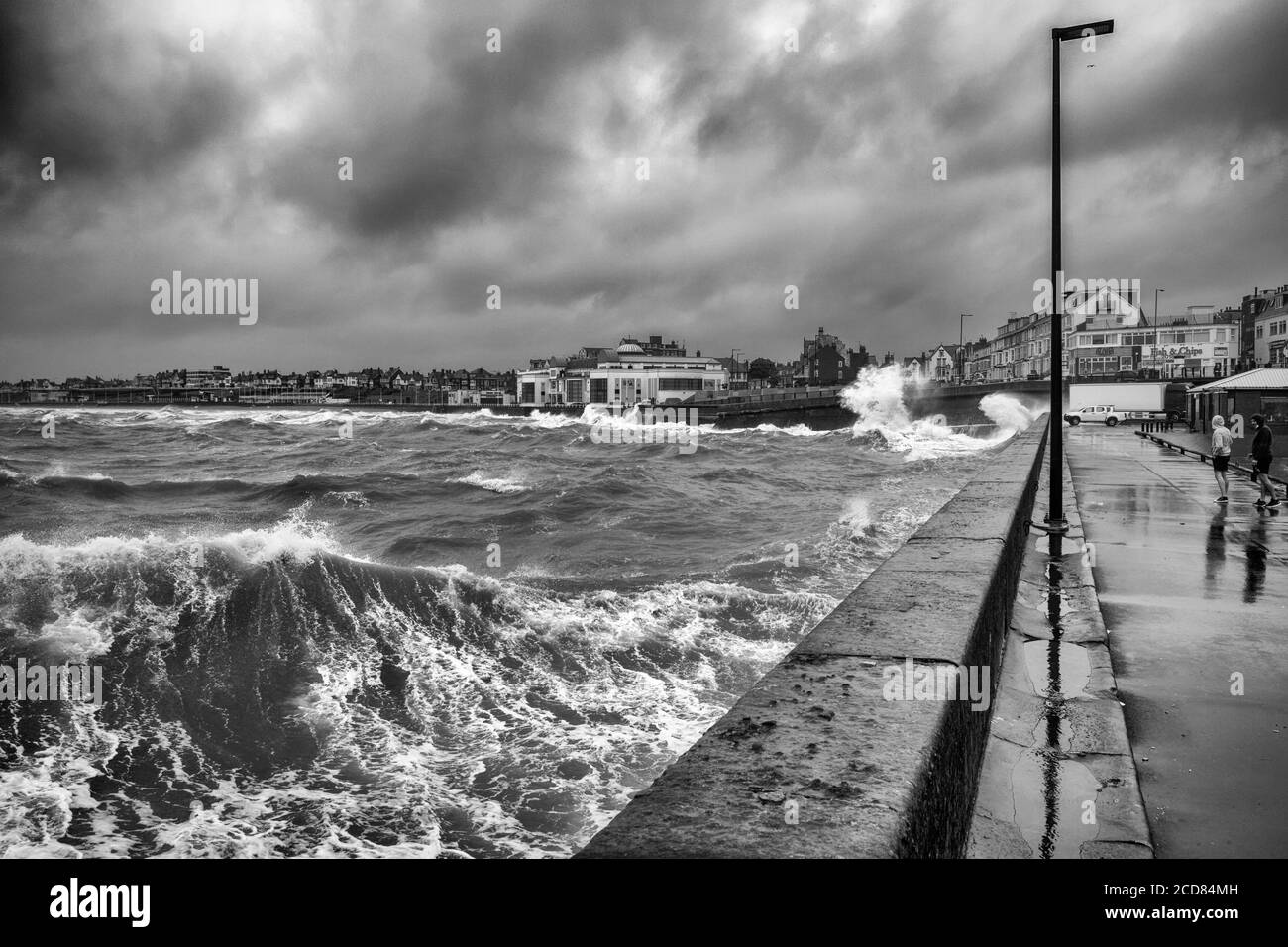 South Beach under threatening clouds and a stormy sea,  Bridlington, Yorkshire, UK Stock Photo