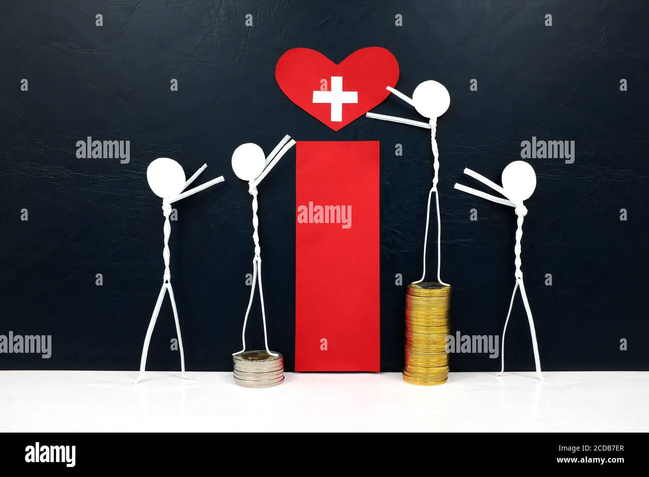Stick figure reaching for a red heart shape with cross cutout while stepping on stack of coins. Healthcare, medical care and hospital access inequality. Stock Photo