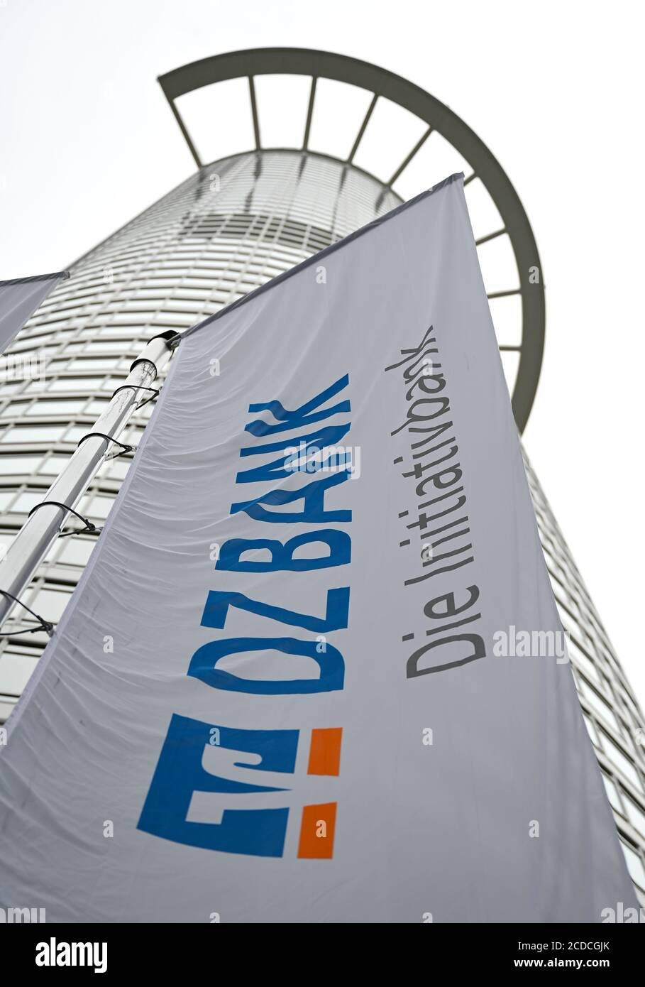 "25 August 2020, Hessen, Frankfurt/Main: A flag with the inscription ""DZ Bank - Die Initiativbank"" hangs in front of the office tower ""Westend 1"", also known as the ""Kronenhochhaus"", which belongs to the headquarters of DZ Bank. The Deutsche Zentral-Genossenschaftsbank (DZ Bank) presents figures for the first half of 2020 on 28.08.2020. Photo: Arne Dedert/dpa Stock Photo"