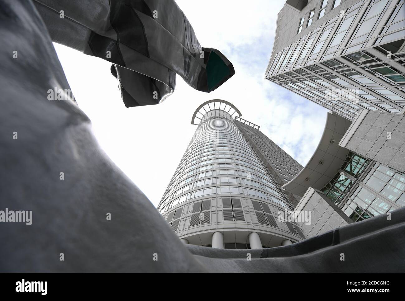 """25 August 2020, Hessen, Frankfurt/Main: The sculpture """"Inverted collar and tie"""" by the US-American Pop Art duo Claes Oldenburg and his wife Coosje van Bruggen stands in front of the office high-rise """"Westend 1"""", also known as the """"Kronenhochhaus"""", which belongs to the headquarters of the DZ Bank. The Deutsche Zentral-Genossenschaftsbank (DZ Bank) presents figures for the first half of 2020 on 28.08.2020. Photo: Arne Dedert/dpa Stock Photo"""