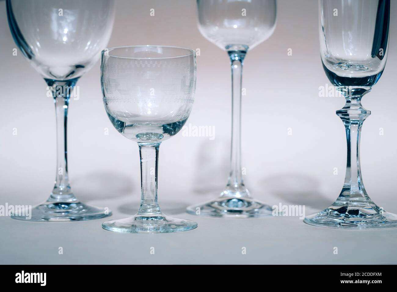 Wine Glasses On A Sunny Table Cast Shadows Sunlight Crystal Glassware Wine Glasses Champagne Flute Stock Photo Alamy